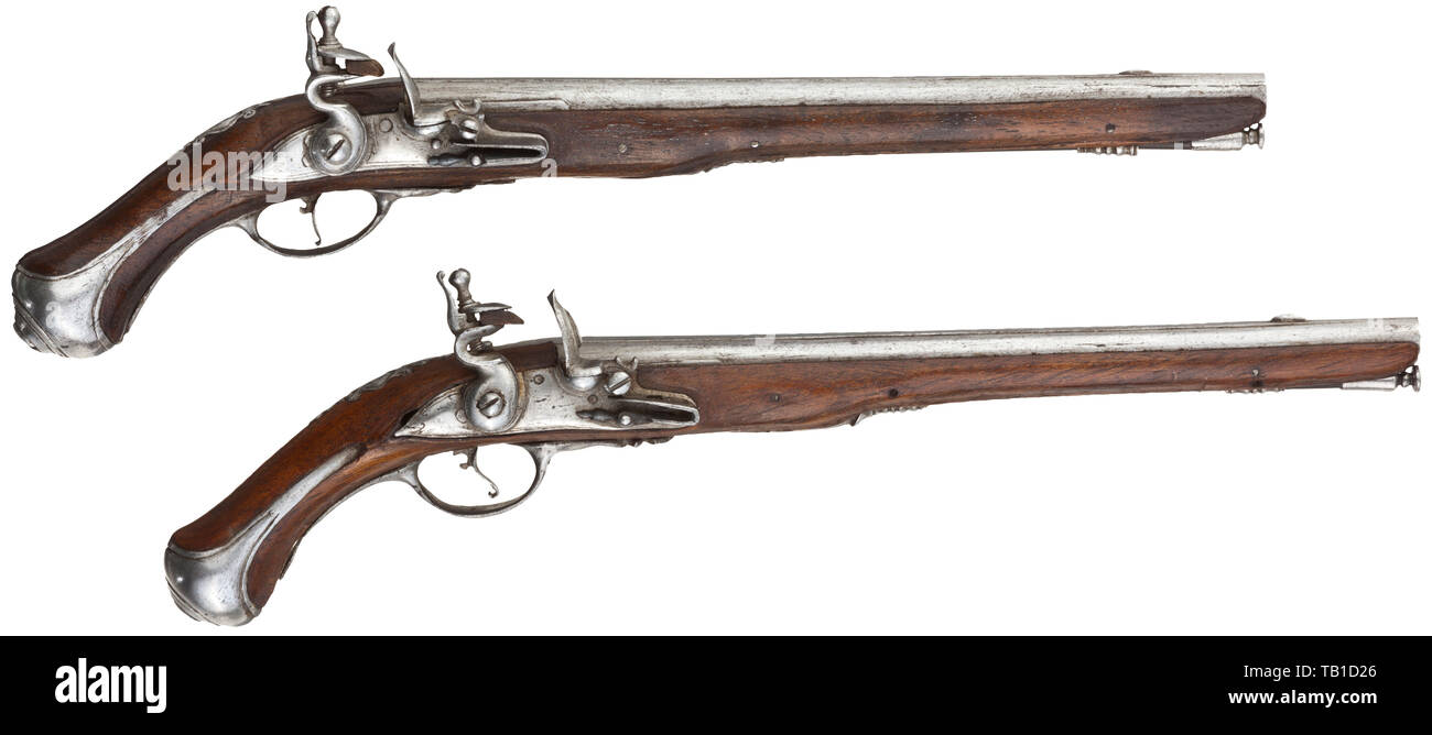 A pair of French miniature pistols, 18th century, Smooth barrels in 3.5 mm calibre with perforated vent holes and distinct barrel rib. Functional, slightly engraved flintlocks. Walnut full stocks with fine openwork side plates and cut iron furniture. Ramrods made of whalebone(?). Length 14 cm. Detailed miniatures of the highest gunsmith quality. miniatures, miniature, small, mini, historic, historical, Additional-Rights-Clearance-Info-Not-Available Stock Photo