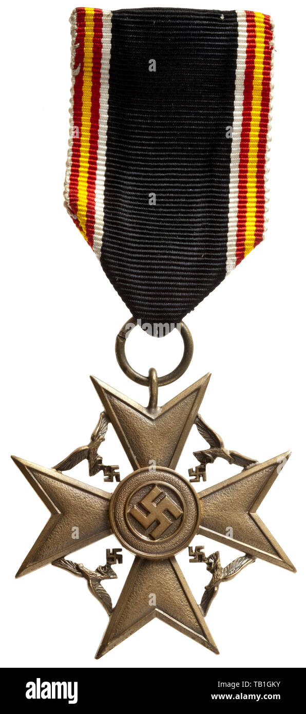 An Honour Cross for surviving dependants of German soldiers who fought in the Spanish Civil War, Bronze-embossed miniature version of the Spanish Cross with applied round medallion and Luftwaffe eagles separately soldered between the cross arms. On the original ribbon customised for wear with safety-pin attachment. Width 41 mm. Weight with ribbon 14.3 g. The Survivor's Cross was established simultaneously with the Spanish Cross on 14 April 1939 and was awarded only 315 times to widows, children, parents or siblings of soldiers killed in action. Since it was assumed on the p, Editorial-Use-Only - Stock Image