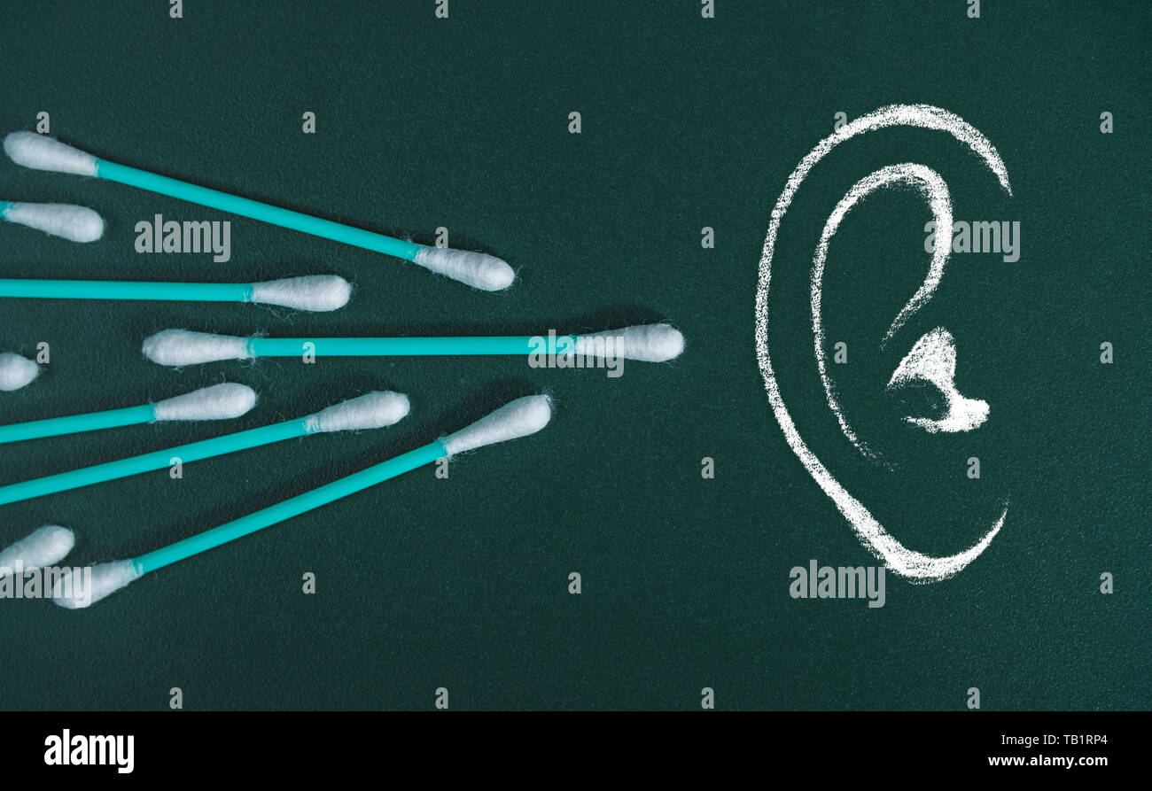 Chalk drawing of ear with real cotton swabs. - Stock Image