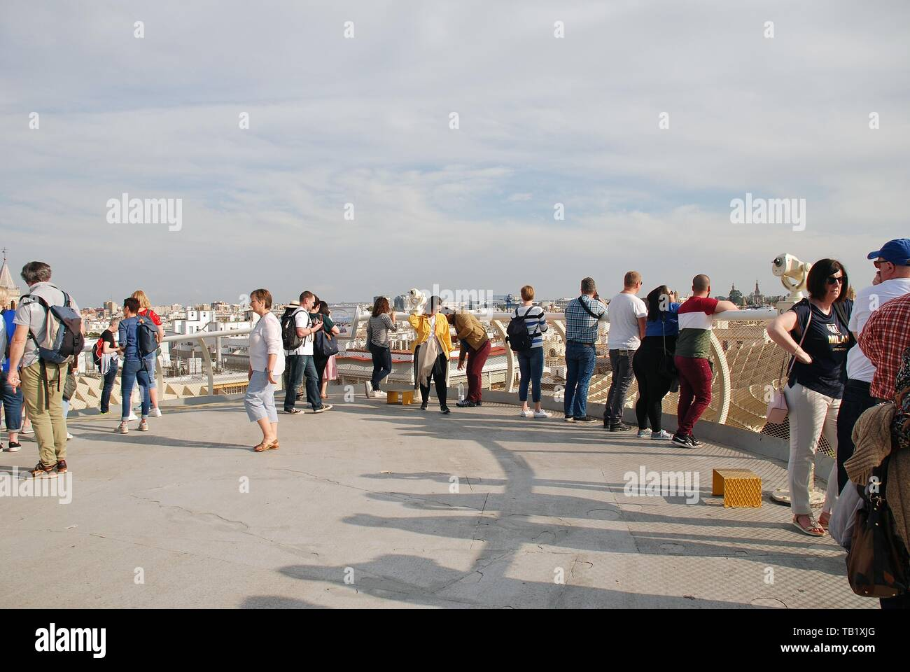 People stand on the viewing platform on the roof of the Metropol Parasol in Seville, Spain on April 2, 2019. Stock Photo