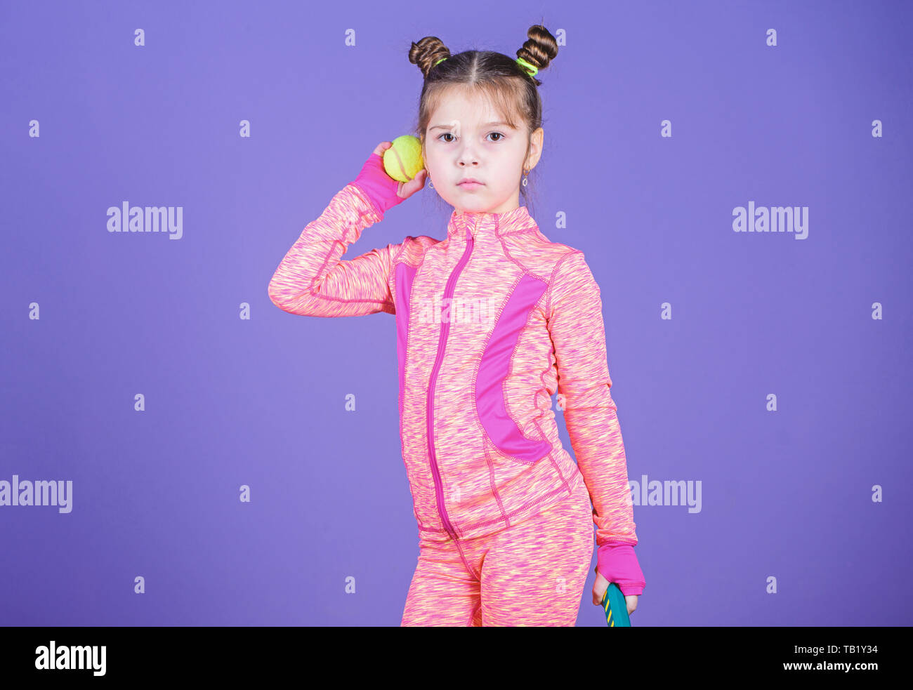 Girl Cute Child Double Bun Hairstyle Tennis Player Active Games Sport Upbringing Small Cutie Likes Tennis Sport Equipment Store Play Tennis For Fun Little Baby Sporty Costume Play Tennis Game Stock Photo