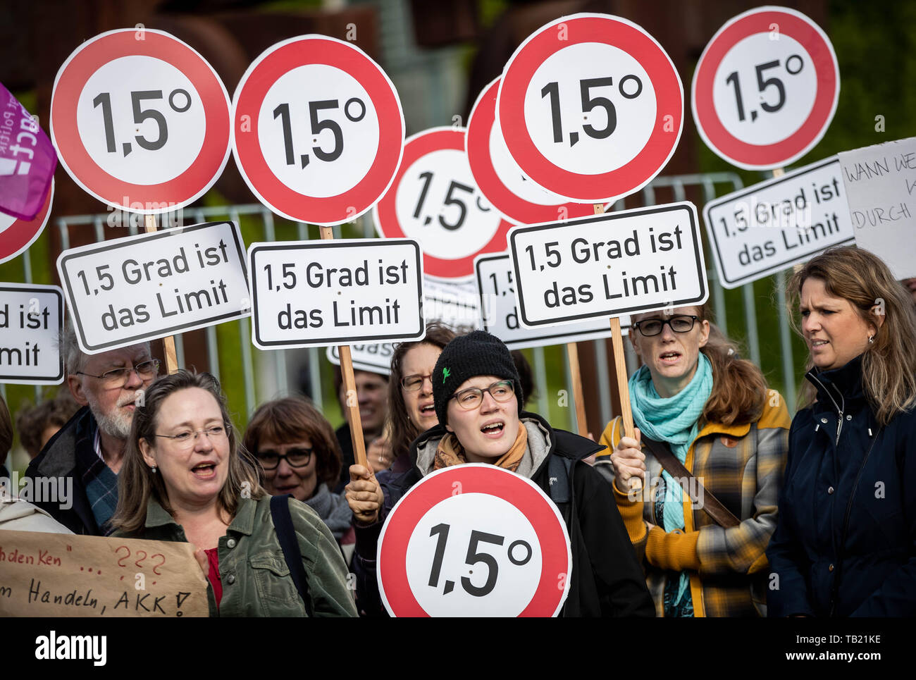 Berlin, Germany. 29th May, 2019. Activists from the Campact campaign organisation stand with signs at 1.5 degrees at a rally that criticises the Union's lack of climate protection. The Climate Cabinet meets at the same time in the Chancellor's Office. Credit: Michael Kappeler/dpa/Alamy Live News Stock Photo
