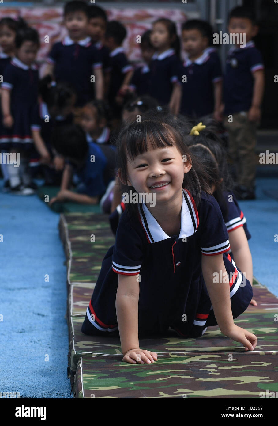 Changxing, China's Zhejiang Province. 29th May, 2019. Children take part in one of a series of extracurricular activities held by the Central Kindergarten in celebration of the upcoming International Children's Day in Lijiaxiang Township of Changxing County, east China's Zhejiang Province, May 29, 2019. Credit: Xu Yu/Xinhua/Alamy Live News - Stock Image