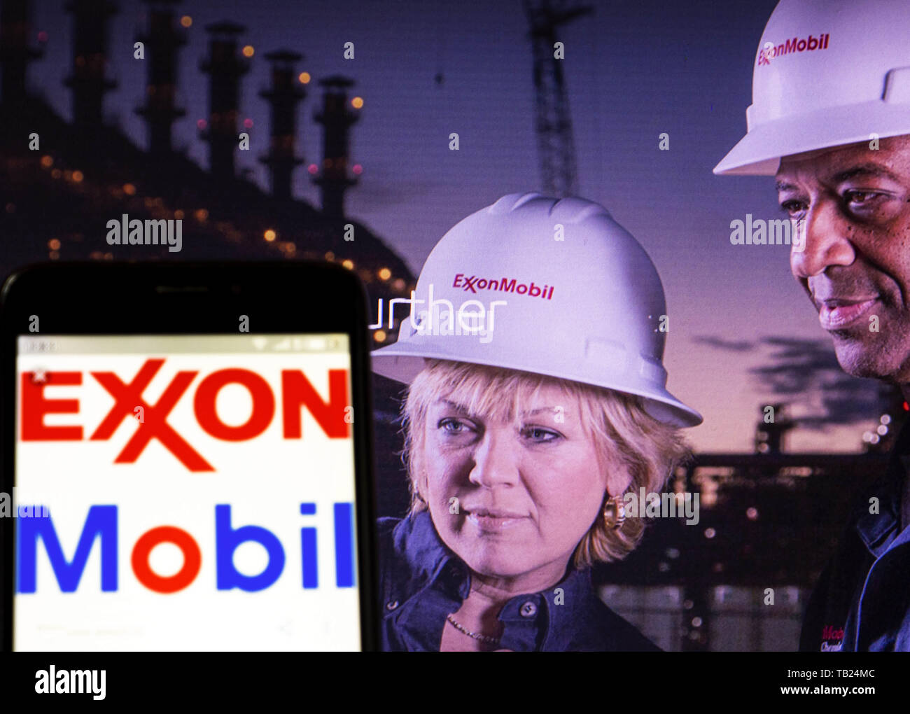 May 28, 2019 - Ukraine - In this photo illustration the Exxon Mobil Corporation logo is seen displayed on a smartphone with a company's official website on the background. (Credit Image: © Igor Golovniov/SOPA Images via ZUMA Wire) - Stock Image