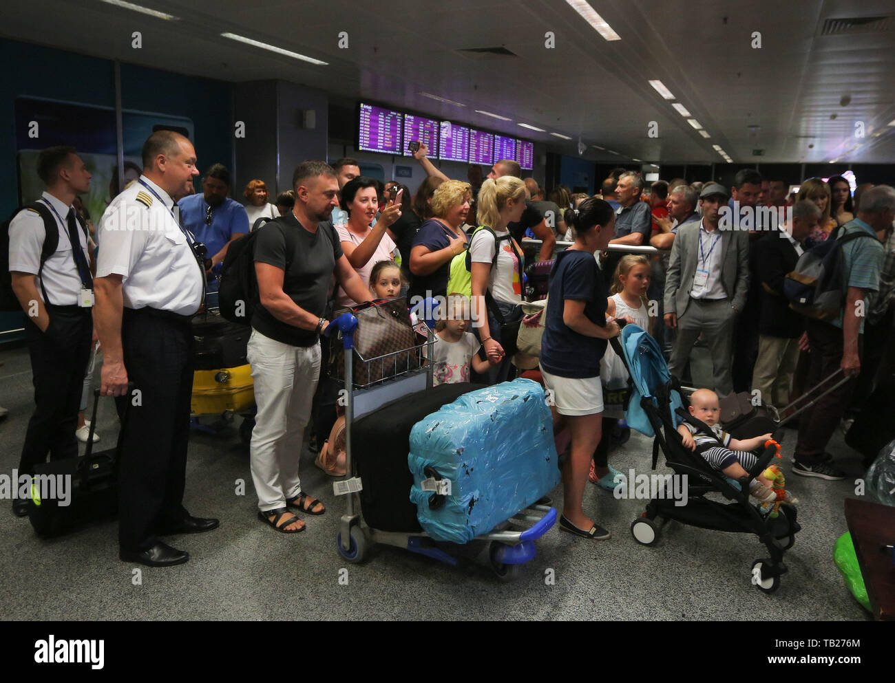 May 29, 2019 - Passengers try to walk through the crowd of supporters who came to greet Mikheil Saakashvili as he arrives at Boryspil International Airport near Kyiv, Ukraine, May 29, 2019. Ukraine's new president has restored the citizenship of former Georgian president Mikheil Saakashvili almost two years after it was removed. (Credit Image: © Sergii KharchenkoZUMA Wire) - Stock Image
