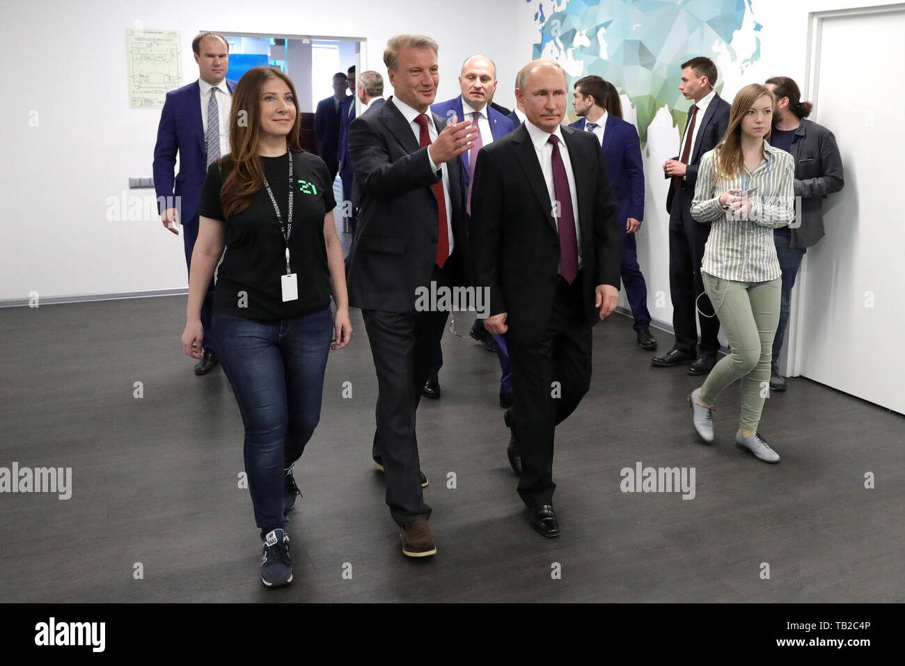 Moscow, Russia. 30th May, 2019. MOSCOW, RUSSIA - MAY 30, 2019: Russia's President Vladimir Putin and German Gref (R-L front), Sberbank CEO and Executive Board Chairman, visit School 21, an IT school opened by Sberbank last year to provide hi-tech companies with programmers. Mikhail Klimentyev/Russian Presidential Press and Information Office/TASS Credit: ITAR-TASS News Agency/Alamy Live News - Stock Image