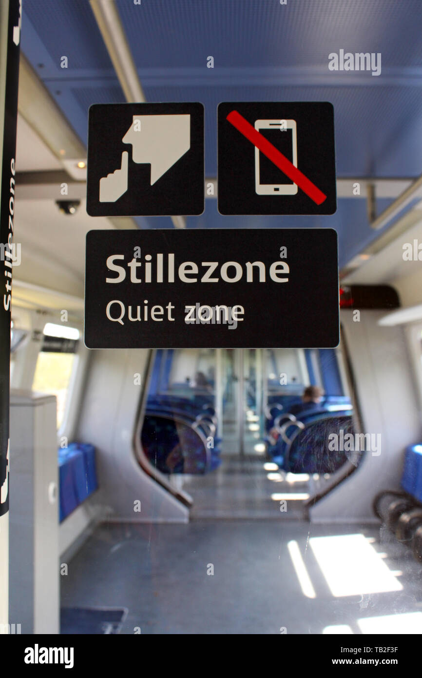 Quiet zone (stillezone) inside of carriage of train, Denmark - Stock Image
