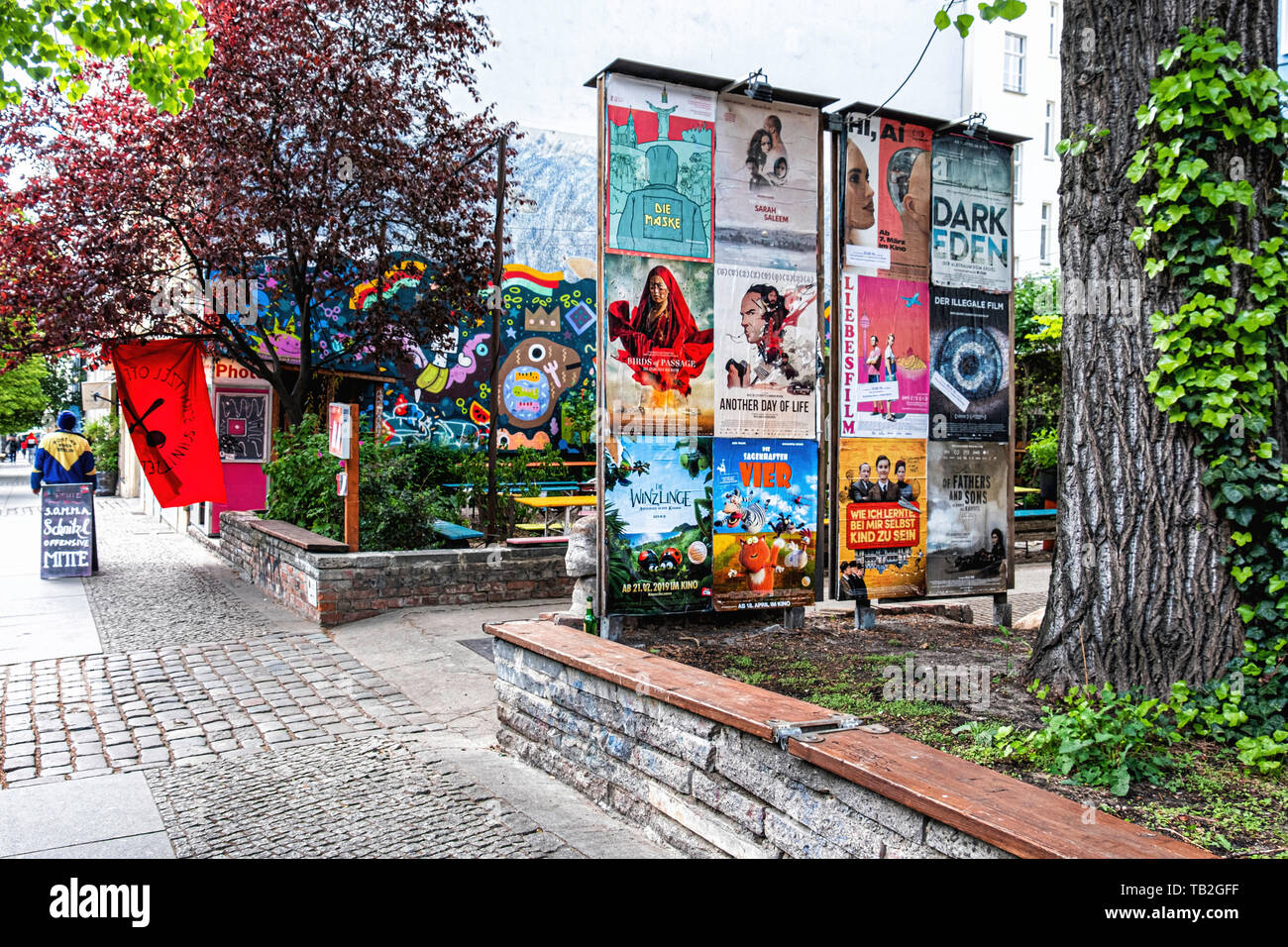 ACUD cultural Centre notice board and colourful wall of Max Fish beer garden in Veteranenstrasse Mitte,Berlin. Stock Photo