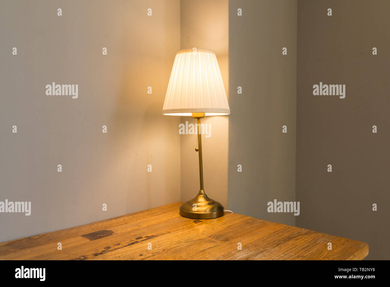 soft lighting on the wooden desk in the room - Stock Image