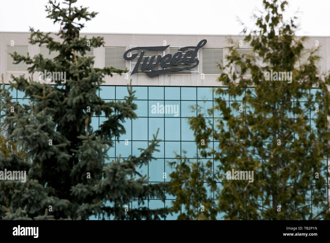 A Tweed logo sign outside of a facility occupied by Canopy Growth Corporation, Trading under the name 'Tweed' in Ottawa, Ontario, Canada, on April 20, Stock Photo