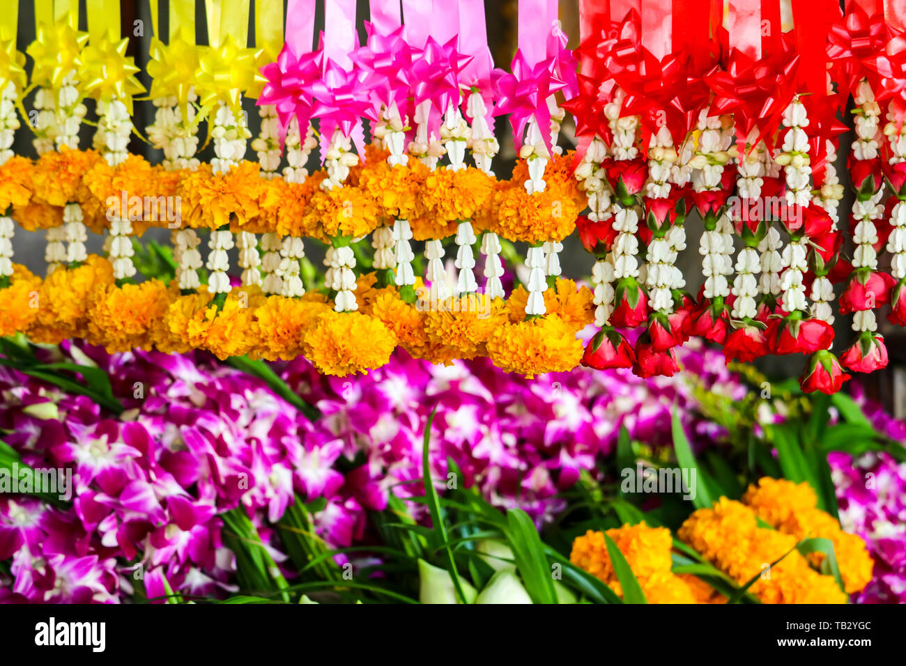 Fresh flower garland Used to worship the sacred things in Buddhism, There are general sales along the road side - Stock Image