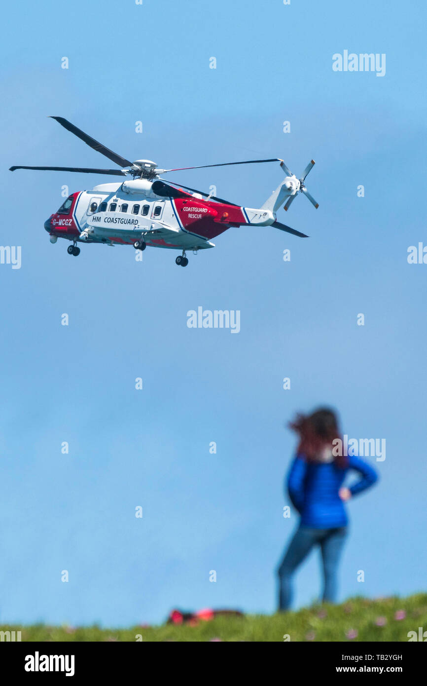 A Sikorsky S-92A HM Coastguard SAR Helicopter G-MCCZ operated by Bristol Helicopters flying overhead in England, UK. - Stock Image