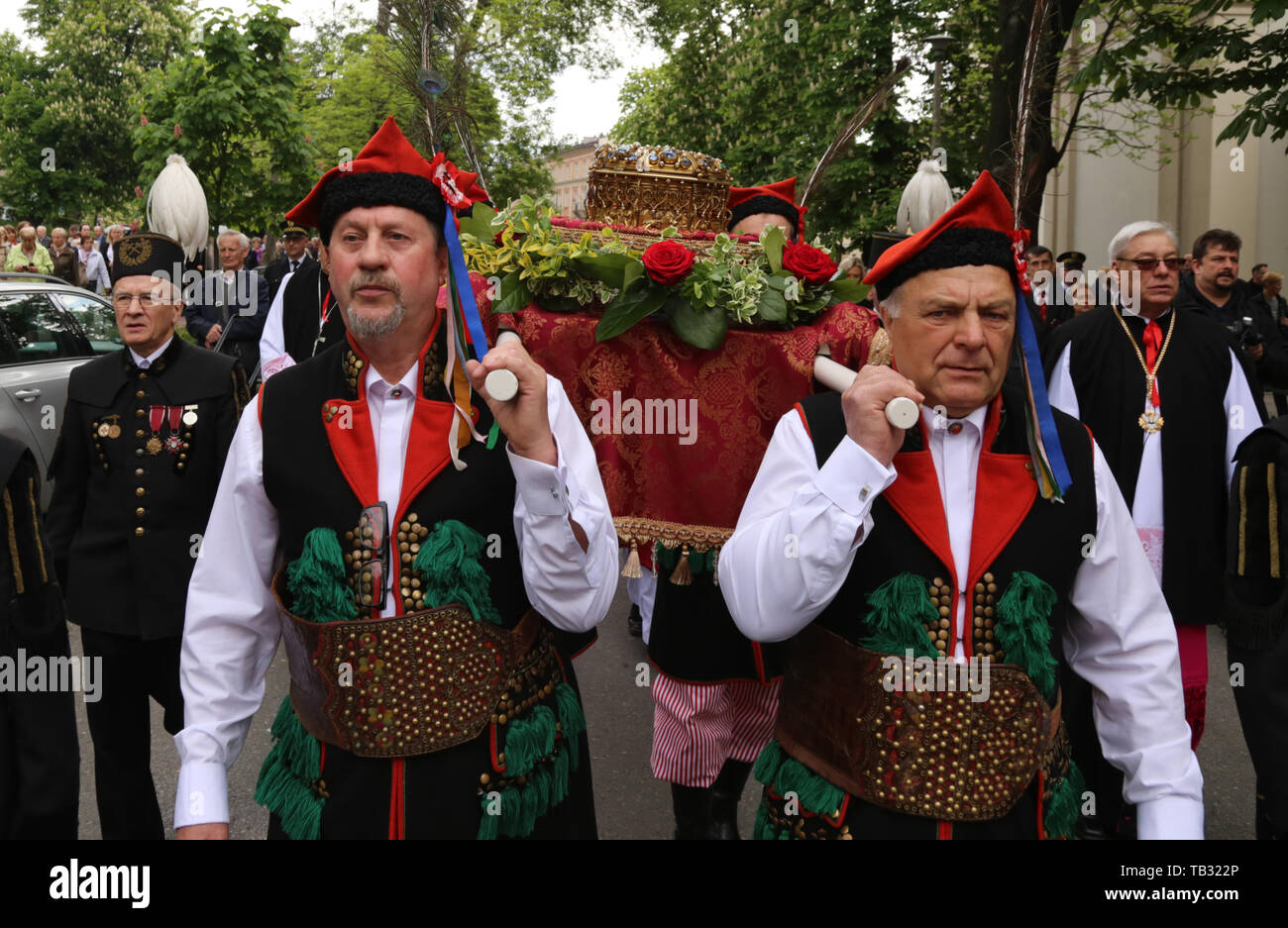 Krakow. Cracow. Poland. St. Stanislaw procession from Wawel to Skalka. Men wearing Krakow regional costumes carry the relic of st. Stanislaw. - Stock Image