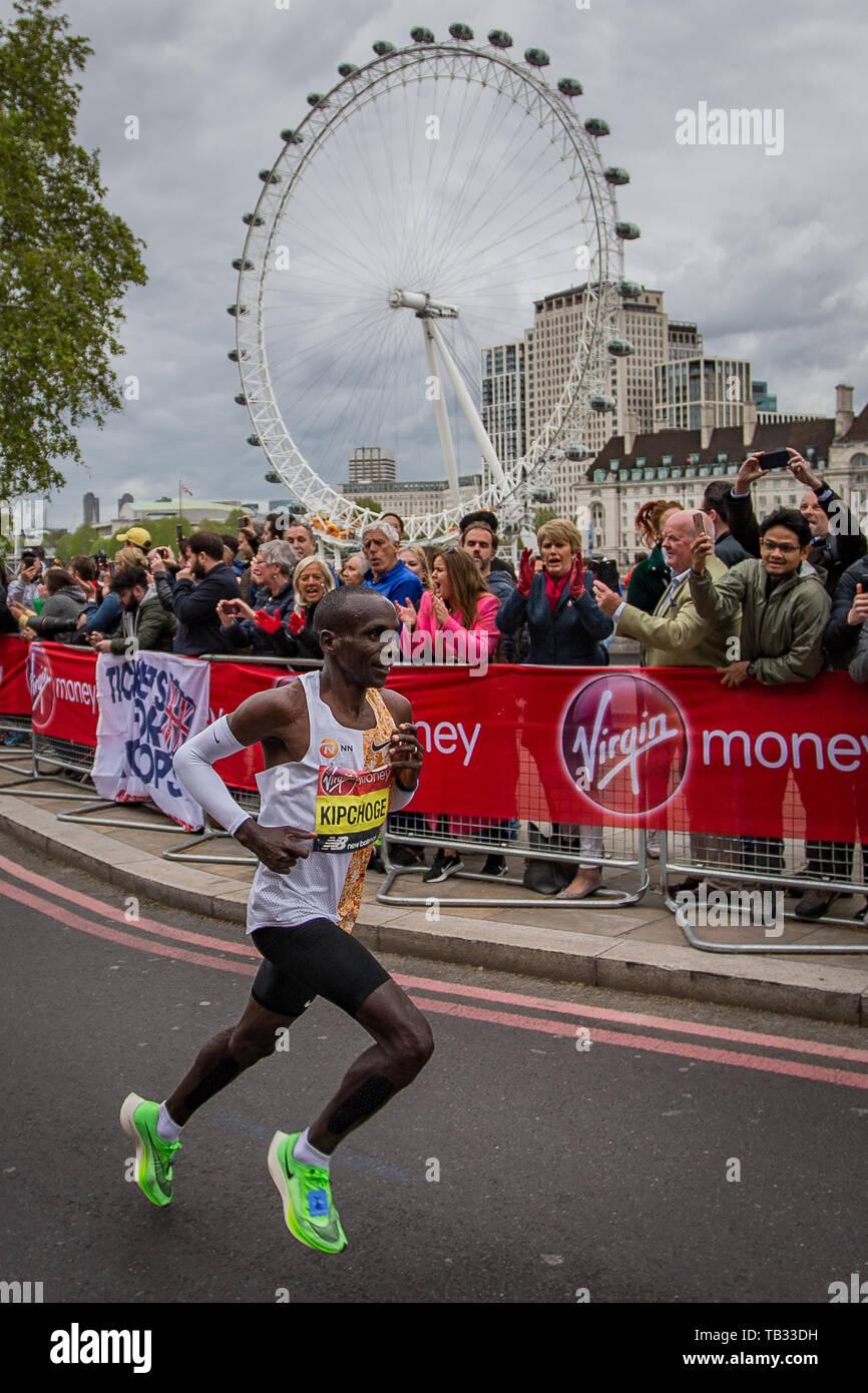 2019 Virgin Money London Marathon elite mens race winner, Eliud Kipchoge, running on the Embankment towards the finish line on the Mall  Featuring: Eliud Kipchoge Where: London, United Kingdom When: 28 Apr 2019 Credit: Wheatley/WENN - Stock Image