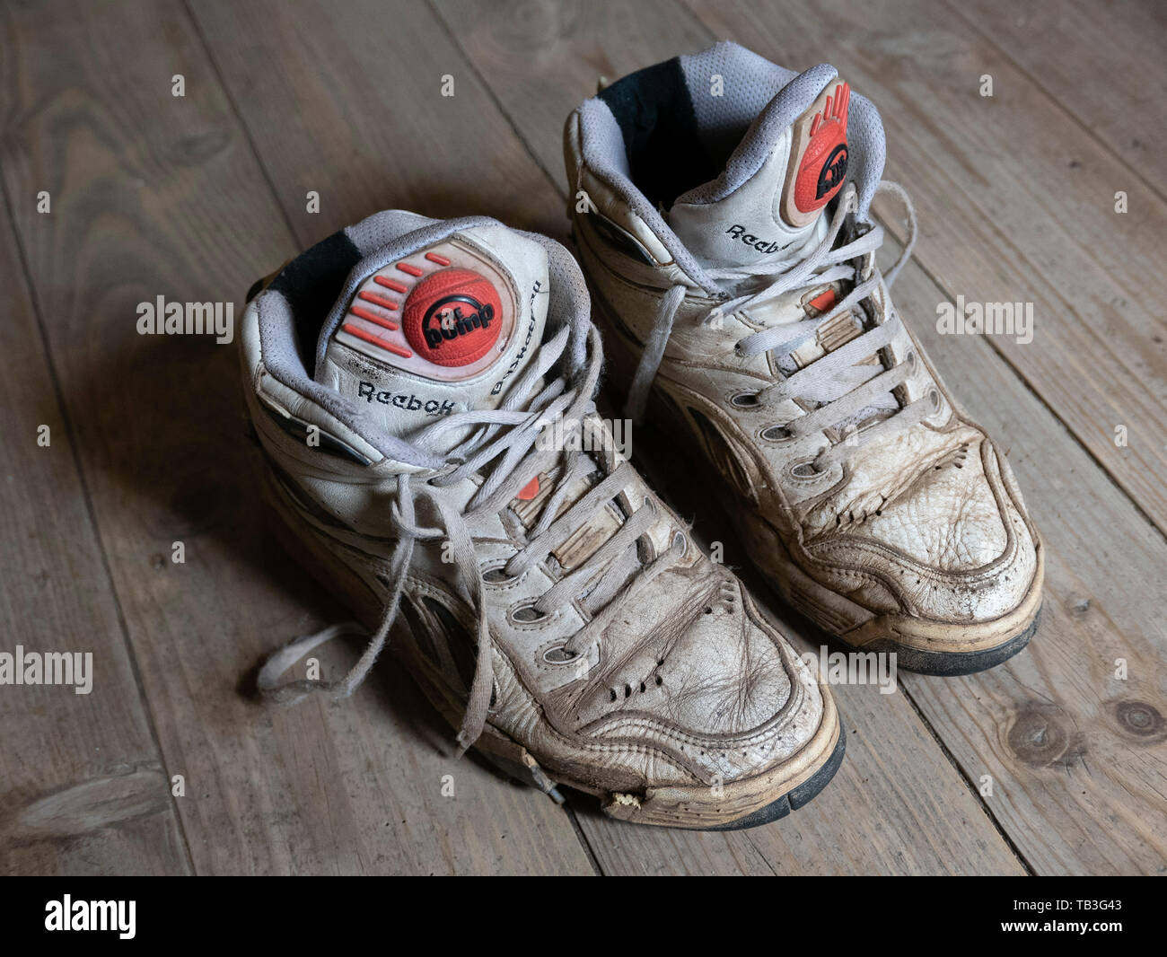 8820a5ee Pair of old worn 1990s Reebok Pump white basketball sneakers - Stock Image