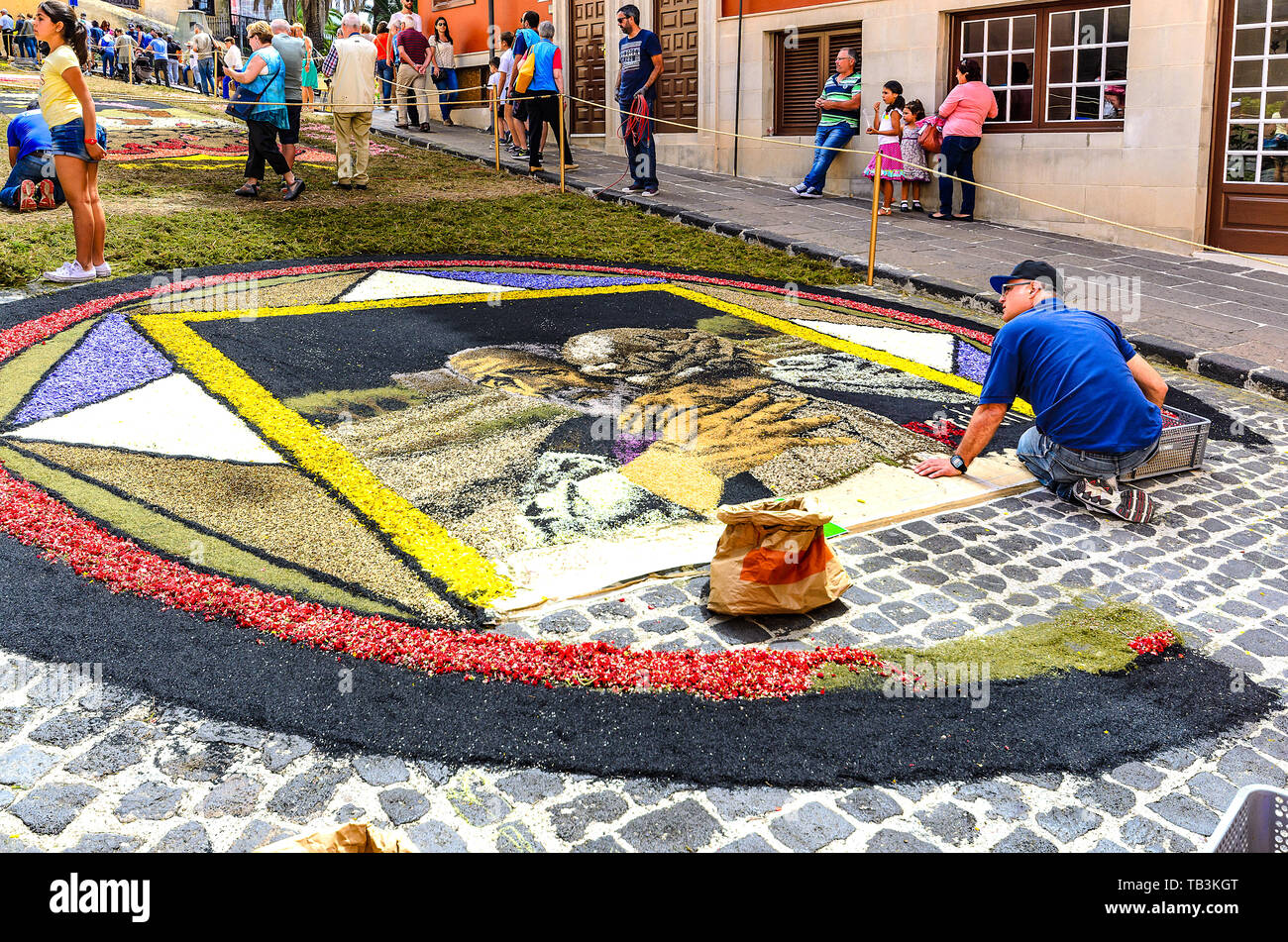 2016/06/15, La Orotava, Spain. During the celebration, carpets made of flower blossoms and salt with various motifs are made on the streets of the cit Stock Photo