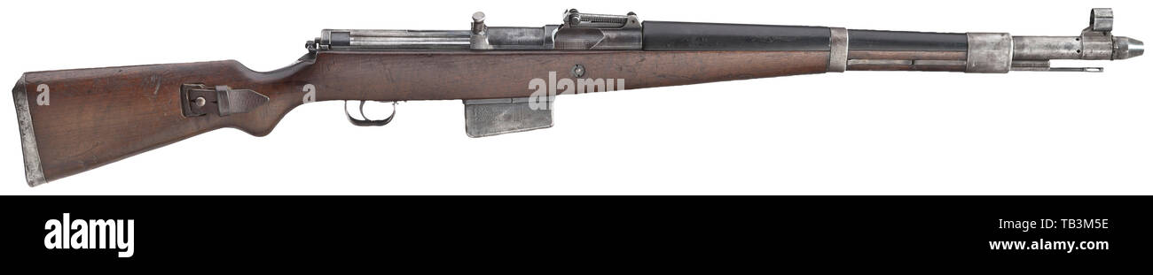 """A G 41(W) self-loading rifle, code """"ac"""", early model, field trials, Undated, circa mid 1941. Bolt release button below cocking handle. No scope rail. Short bolt guide rib (Kammerbahn-Rippe). Recoil spring rod ribbed at the end. Cal. 8 x 57, no. 2028. Completely matching-numbered. Good bore. On left side of cartridge case marked """"G 41(W) - 2028ac"""". Acceptance mark eagle/359 on all parts. Original bluing partly spotted. Dark walnut stock with wear marks. Black Bakelite hand guard. Complete with original strap and cleaning rod. Very rare collector's, Additional-Rights-Clearance-Info-Not-Available Stock Photo"""