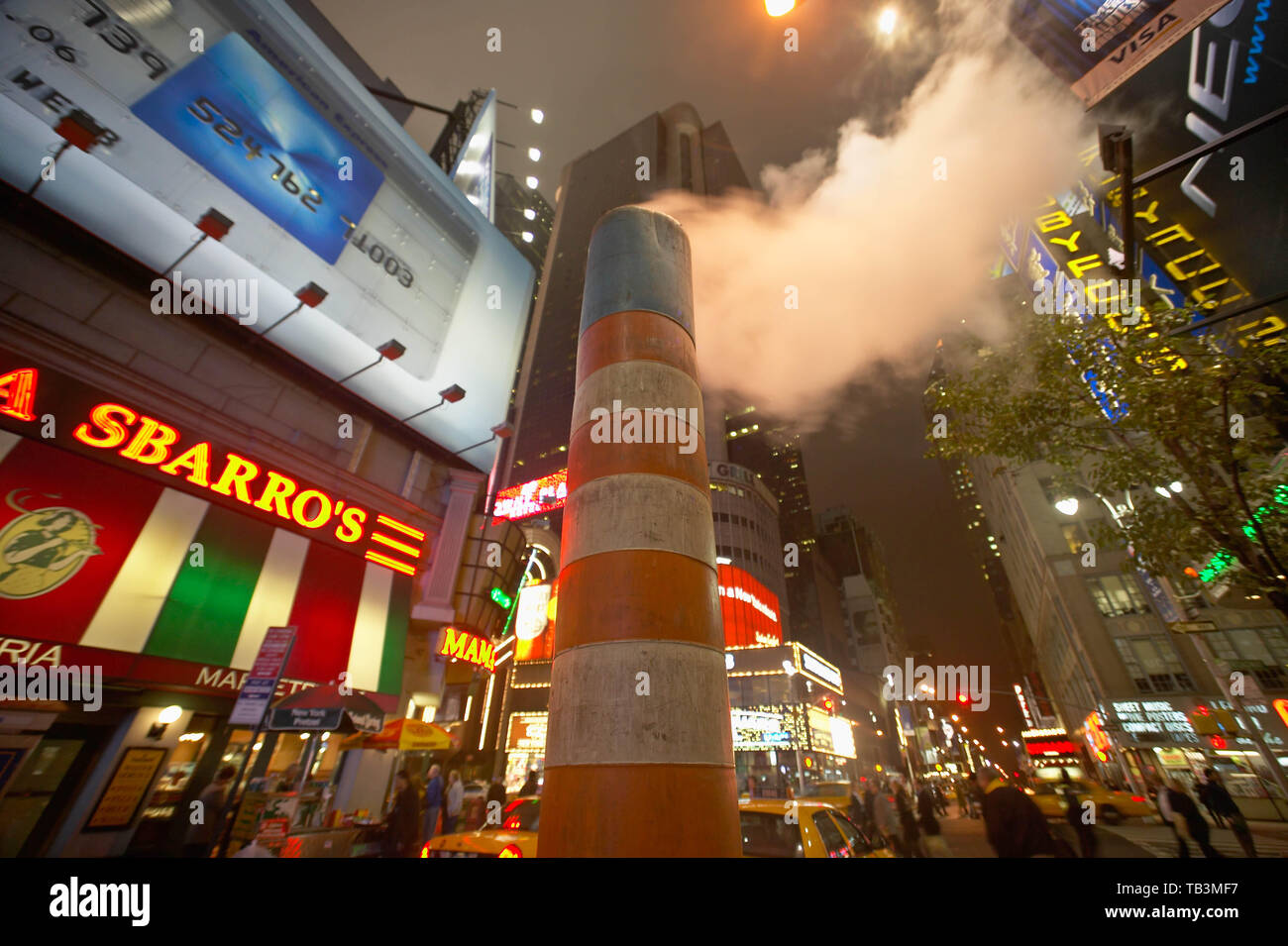 Orange steam vent in street in Times Square at West 49th Street and Broadway, New York, NY - Stock Image