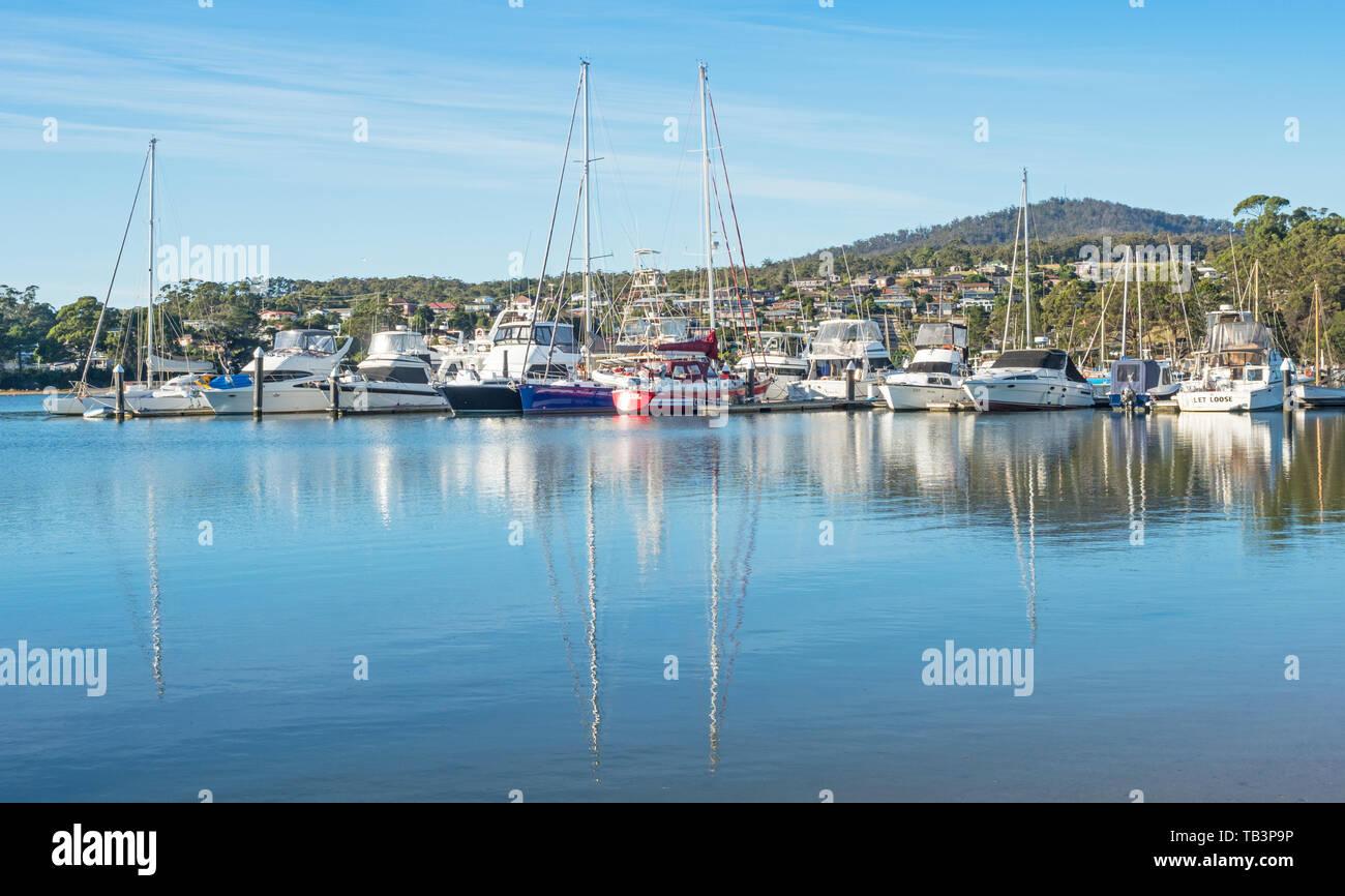 TASMANIA, AUSTRALIA - MARCH 7, 2019: A variety of boats moored in St Helens on the East Coast of Tasmania in Australia. Stock Photo