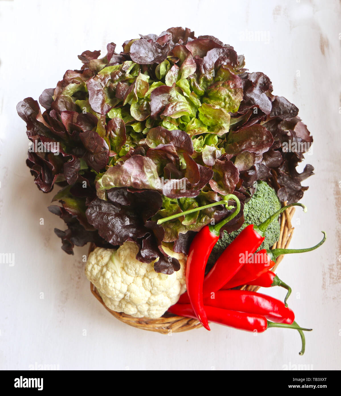 Red batavia lettuce, cauliflower and red peppers: ingredients of summer salads Stock Photo