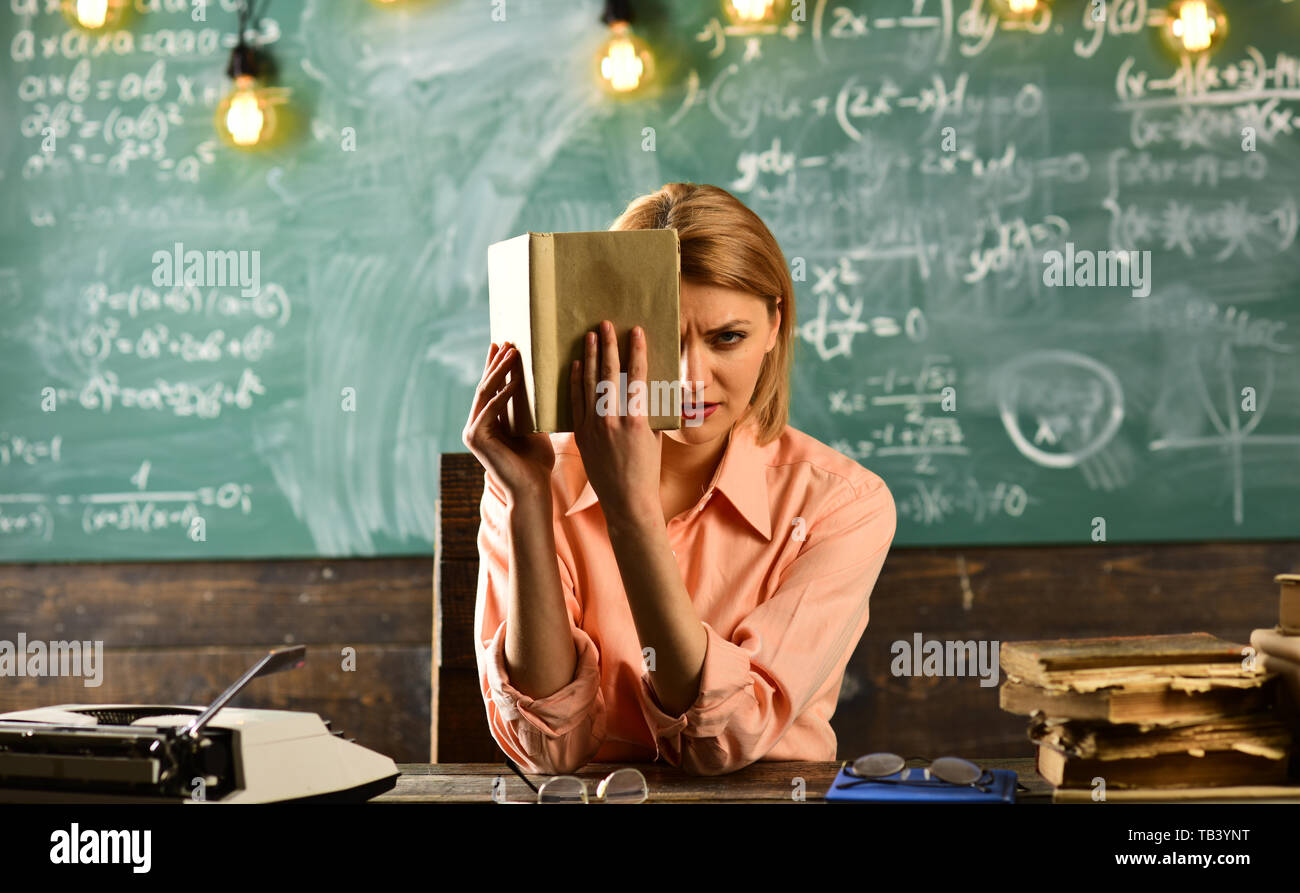 Private detective research. Information. Literature lesson with grammar book. Back to school and home schooling. New technology in modern school - Stock Image