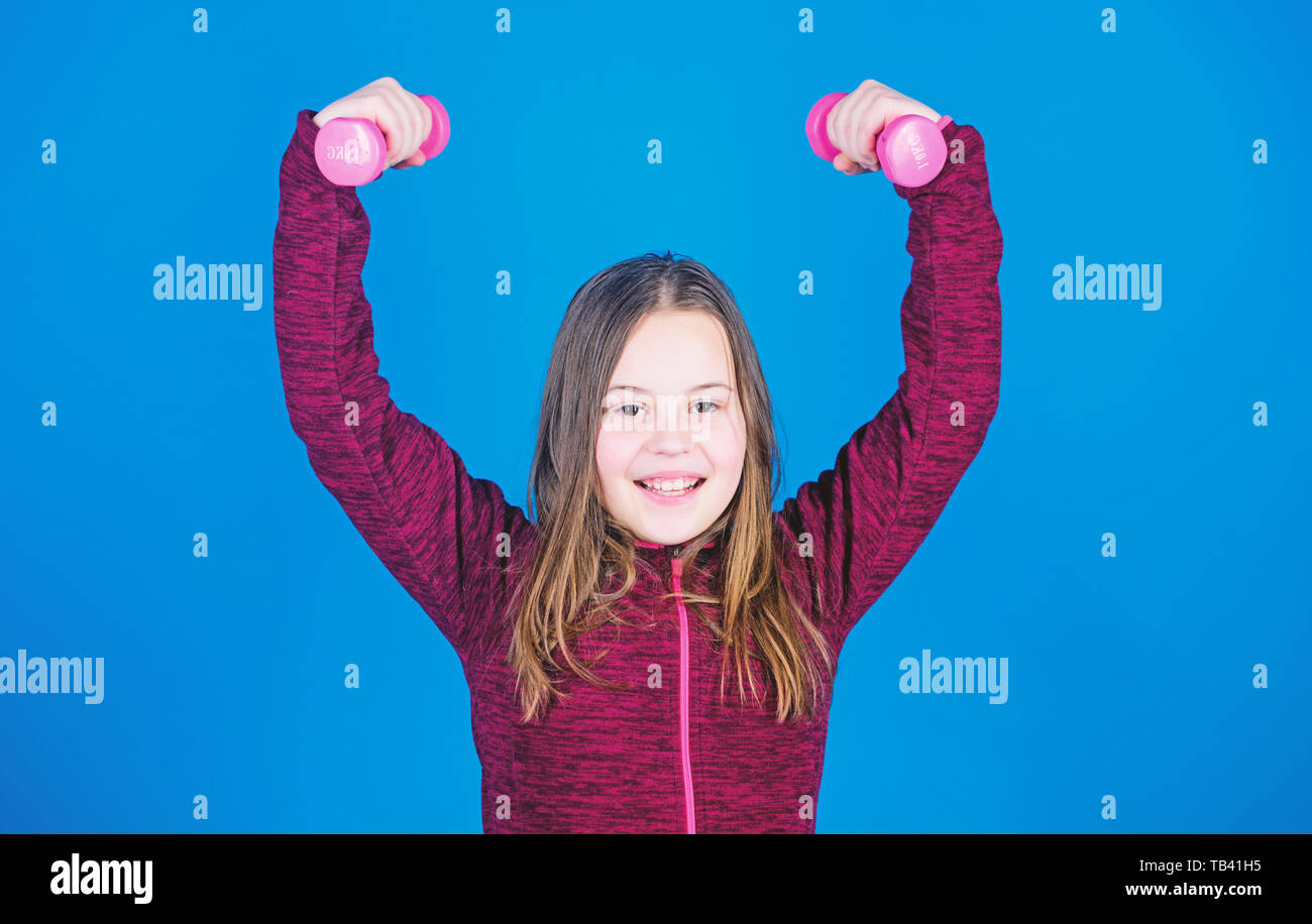 Toward stronger body  Girl exercising with dumbbell  Beginner