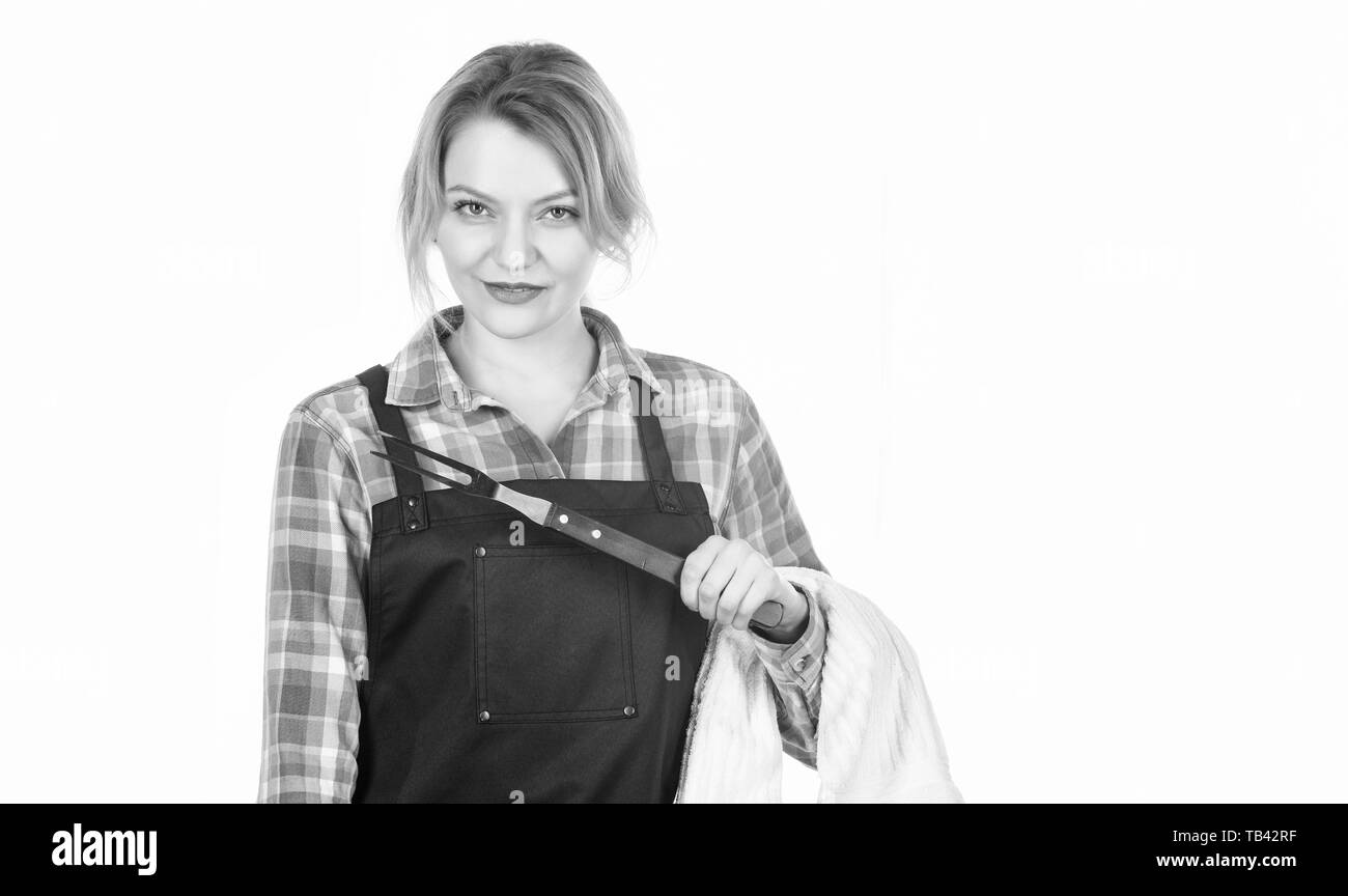 Everything should be perfect. copy space. Pretty girl in chef apron. Preparation and culinary. Woman hold kitchen utensils. Tools for roasting meat outdoor. food cooking recipe. Family weekend. - Stock Image