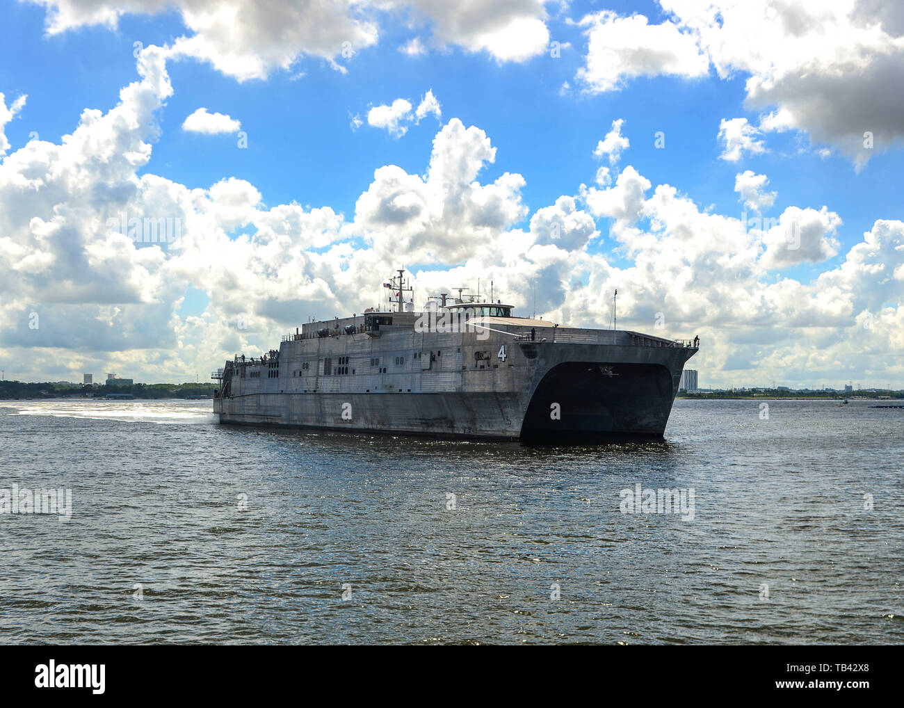 190528-N-FV739-059  SINGAPORE (May 28, 2019) The Military Sealift Command expeditionary fast transport ship USNS Fall River (T-EPF 4) arrives in Sembawang Wharves following its last Pacific Partnership mission stop in Thailand. Pacific Partnership, now in its 14th iteration, is the largest annual multinational humanitarian assistance and disaster relief preparedness mission conducted in the Indo-Pacific. Each year the mission team works collectively with host and partner nations to enhance regional interoperability and disaster response capabilities, increase security and stability in the regi - Stock Image