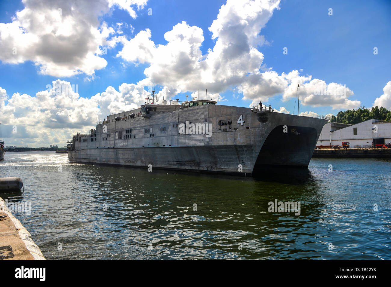 190528-N-FV739-065  SINGAPORE (May 28, 2019) The Military Sealift Command expeditionary fast transport ship USNS Fall River (T-EPF 4) pulls into the Sembawang Wharves following its last Pacific Partnership mission stop in Thailand. Pacific Partnership, now in its 14th iteration, is the largest annual multinational humanitarian assistance and disaster relief preparedness mission conducted in the Indo-Pacific. Each year the mission team works collectively with host and partner nations to enhance regional interoperability and disaster response capabilities, increase security and stability in the  - Stock Image