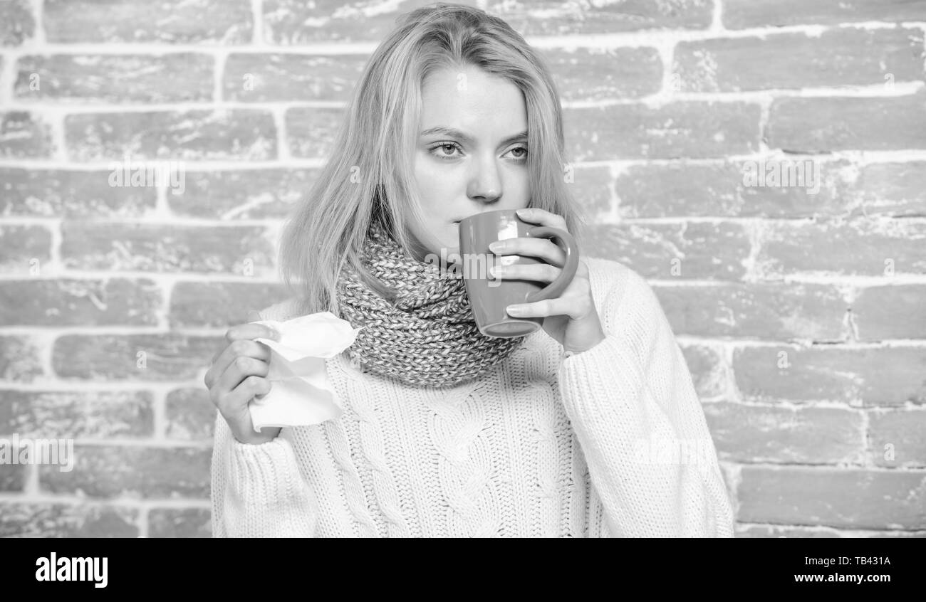 Girl hold tea mug and tissue. Runny nose and other symptoms of cold. Cold and flu remedies. Drink more liquid get rid of cold. Drinking plenty fluid important for ensuring speedy recovery from cold. - Stock Image