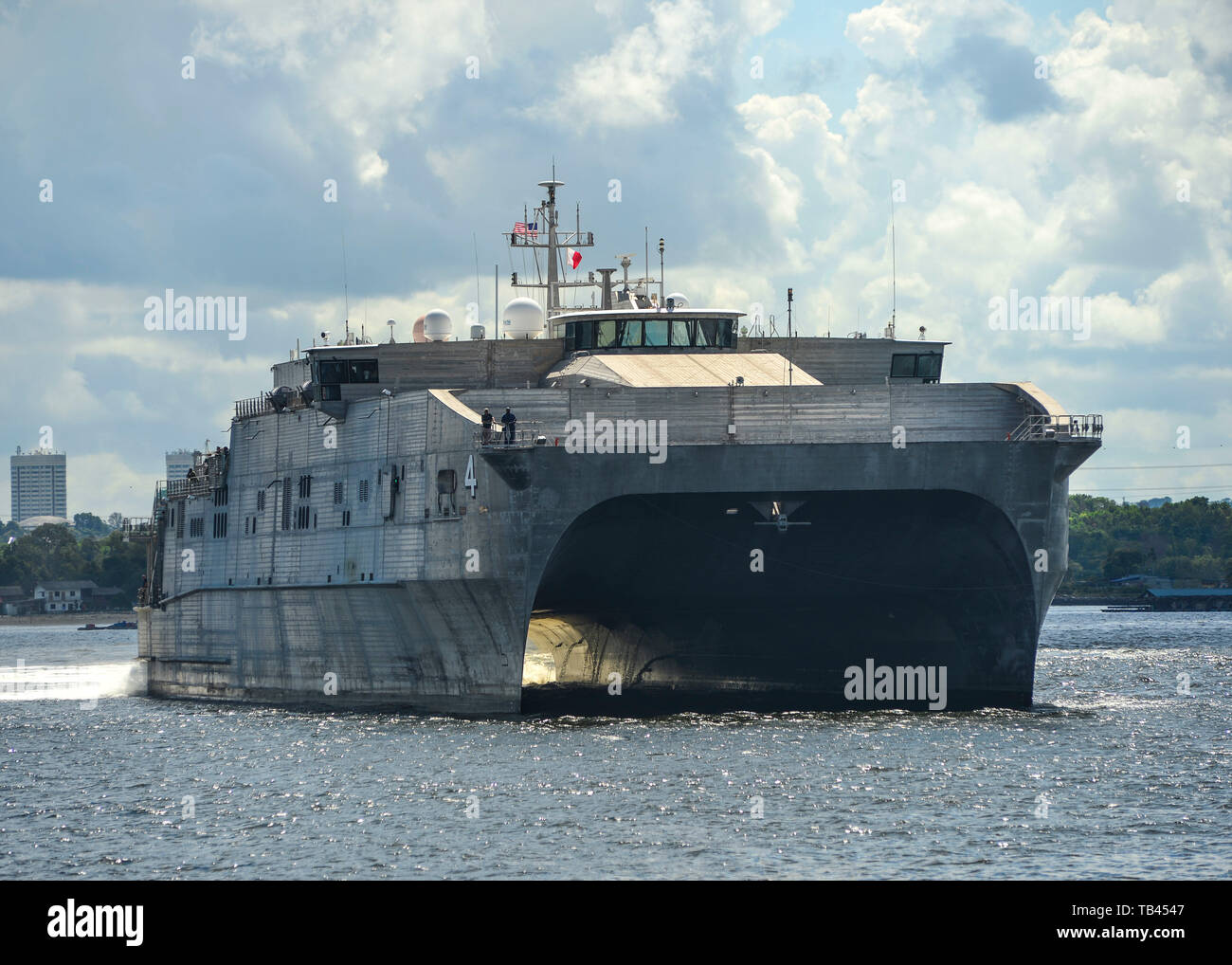 190528-N-FV739-047  SINGAPORE (May 28, 2019) The fast expeditionary transport ship USNS Fall River (T-EPF 4) pulls into the Sembawang Wharves following its last Pacific Partnership mission stop in Thailand. Pacific Partnership, now in its 14th iteration, is the largest annual multinational humanitarian assistance and disaster relief preparedness mission conducted in the Indo-Pacific. Each year the mission team works collectively with host and partner nations to enhance regional interoperability and disaster response capabilities, increase security and stability in the region, and foster new an - Stock Image