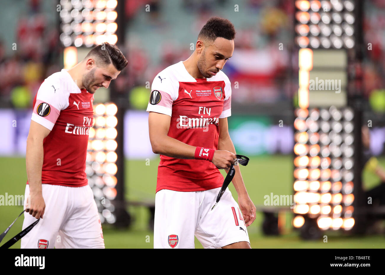 Arsenal's Sead Kolasinac (left) and Pierre-Emerick Aubameyang take off their runners-up medals after the UEFA Europa League final at The Olympic Stadium, Baku, Azerbaijan. - Stock Image