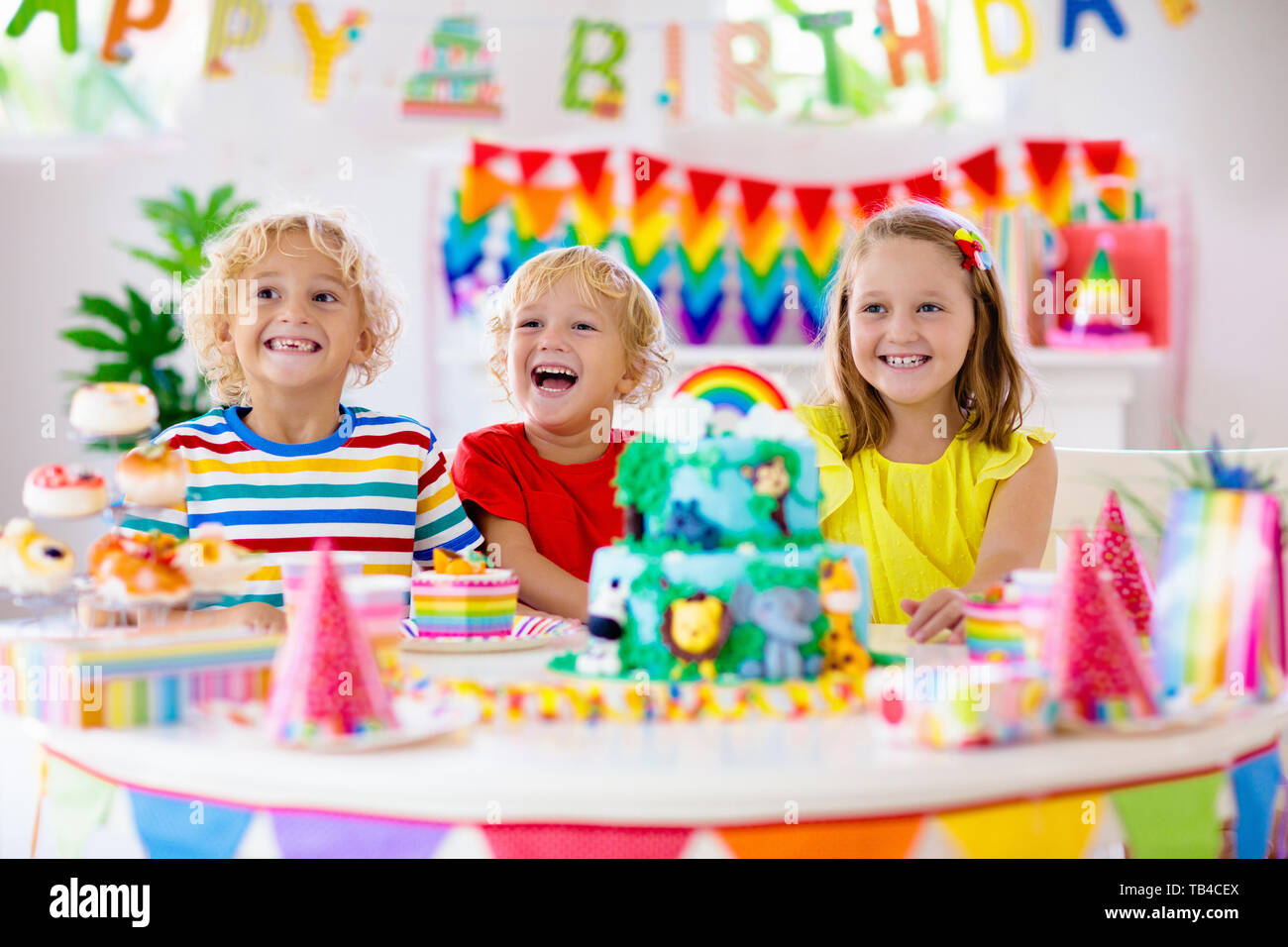 Astonishing Kids Birthday Party Child Blowing Candles On Cake And Opening Personalised Birthday Cards Sponlily Jamesorg