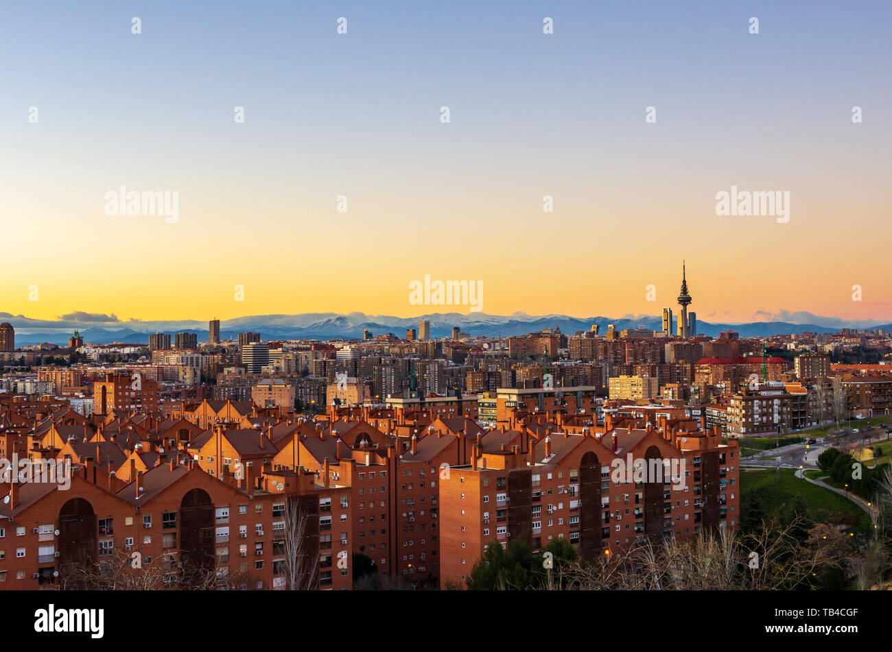Skyline of Madrid at sunset with Sierra de Guadarrama range in background Stock Photo