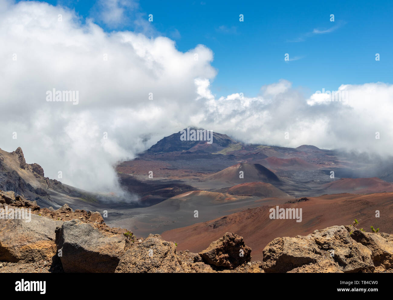 Clouds rolling over beautiful mountains with vivid colors at Haleakala National Park Stock Photo