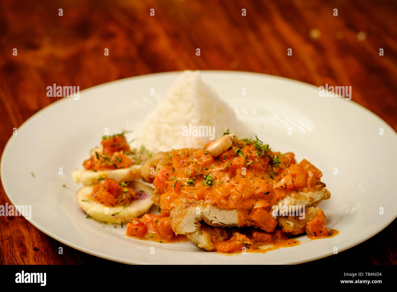 Peruvian Fried Fish A Lo Macho With Rice Or Pescado A Lo Macho Prepared In A Peruvian Cooking Workshop In Arequipa Peru Stock Photo Alamy