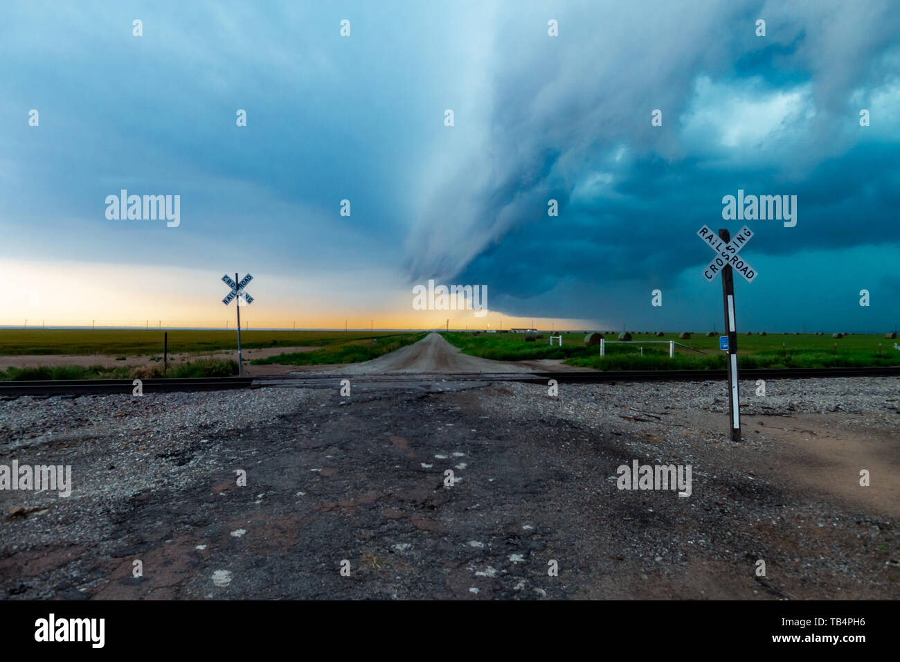 Squall Line converging over a gravel road from a North Texas Super Cell - Stock Image