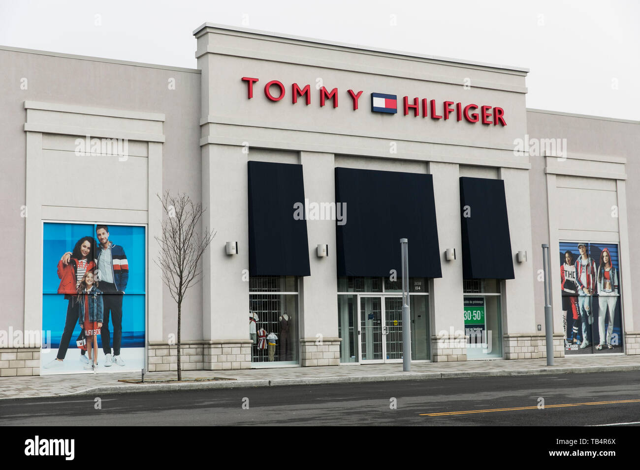 6c9e3a152eb A logo sign outside of a Tommy Hilfiger retail store location in  Vaudreuil-Dorion,
