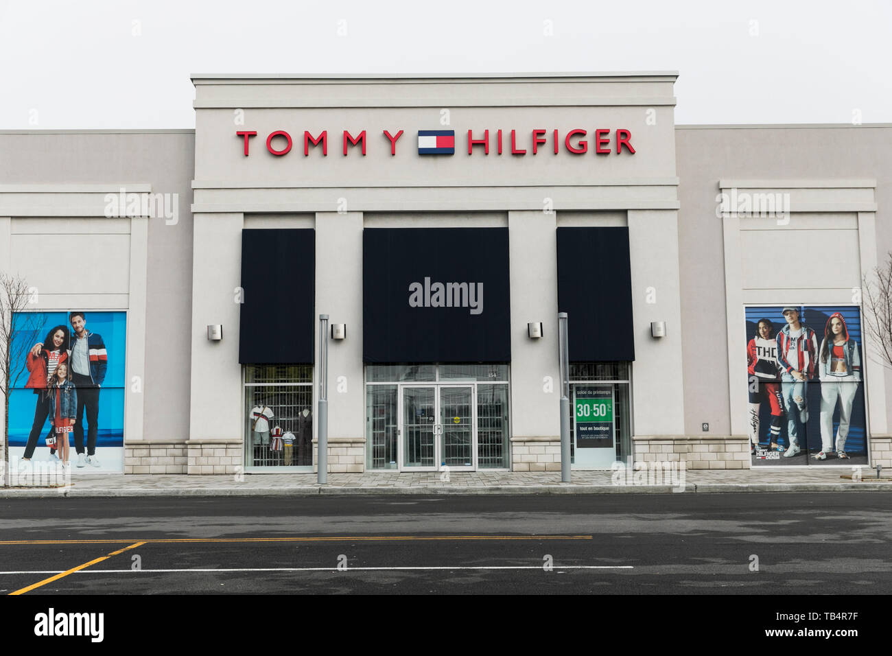 8223e61c A logo sign outside of a Tommy Hilfiger retail store location in  Vaudreuil-Dorion,