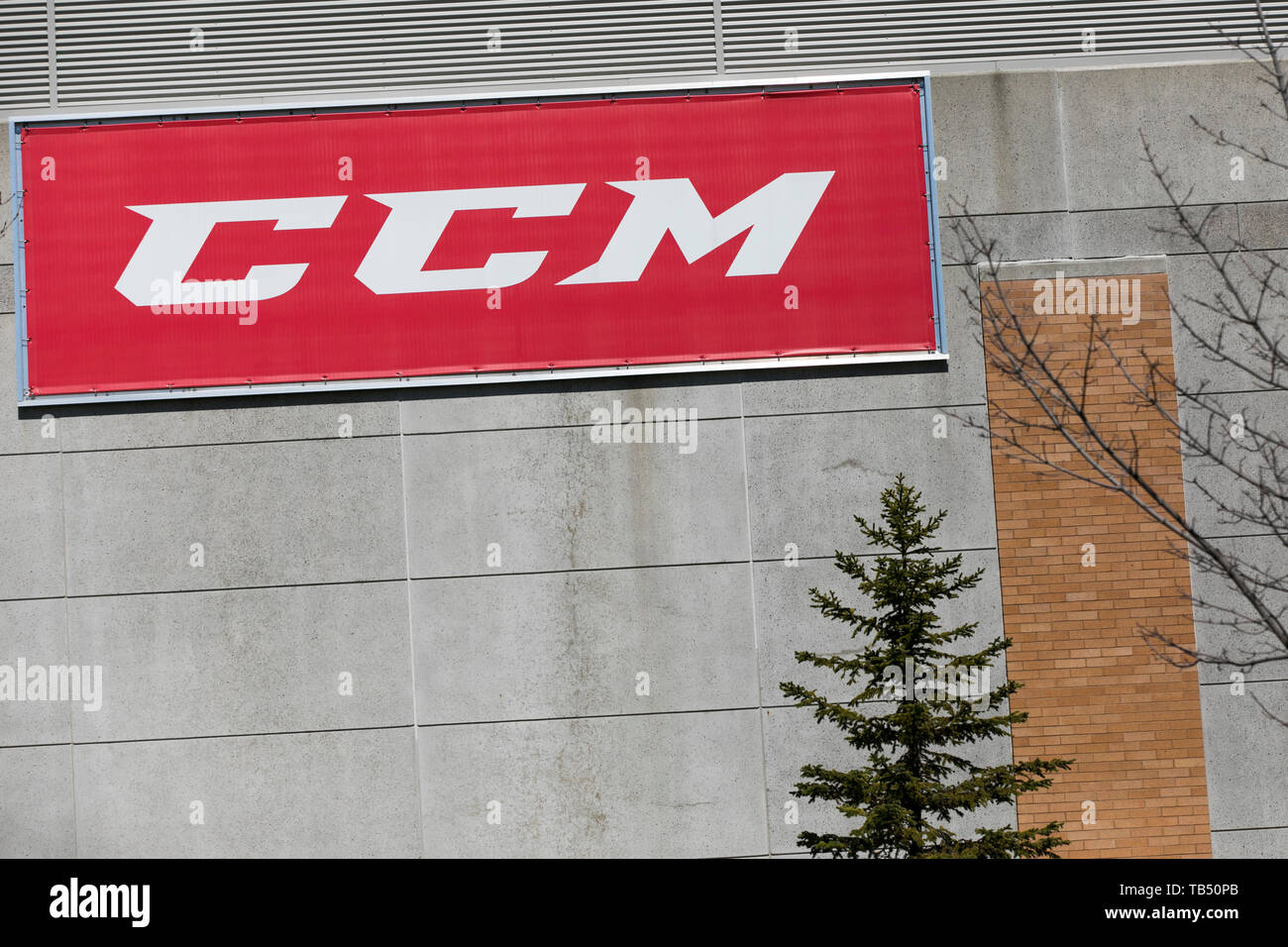 A logo sign outside of a facility occupied by Sport Maska Inc. (CCM Hockey) in Saint-Laurent, Quebec, Canada, on April 21, 2019. - Stock Image