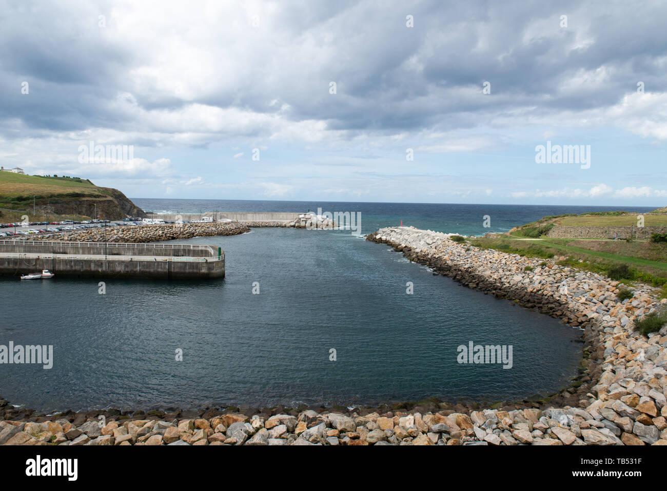 Manmade harbour - with blocks of concrete -, Puerto de Vega, Asturias, Spain. - Stock Image