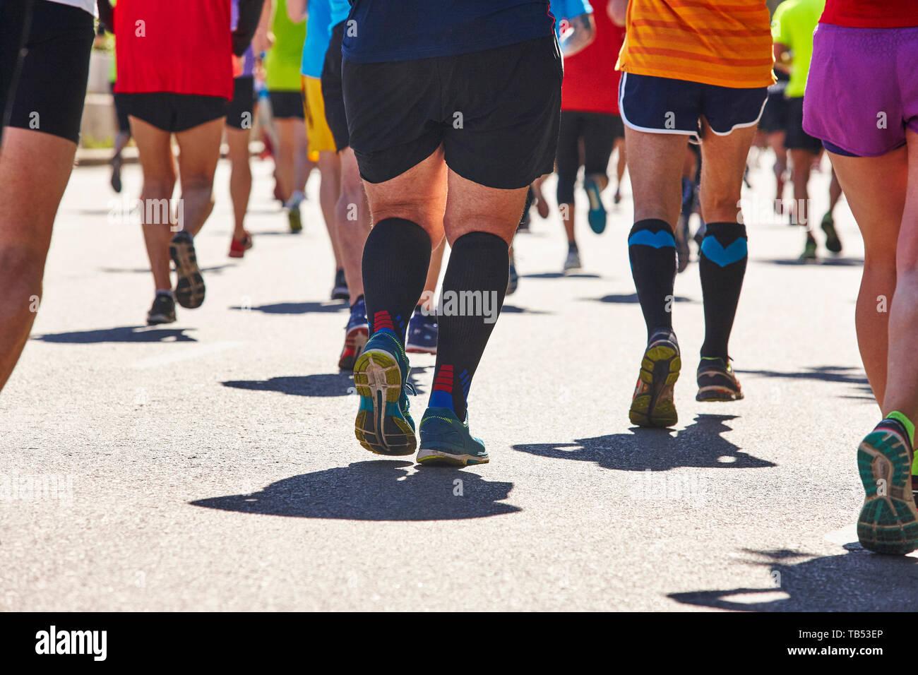 Marathon runners on the street. Healthy lifestyle. Urban athlete endurance - Stock Image