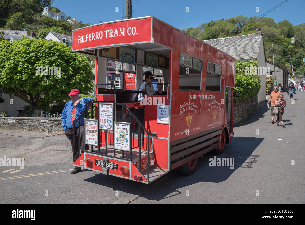 Polperro public transport. Vistors have to park their cars in the car park  outside the village. - Stock Image