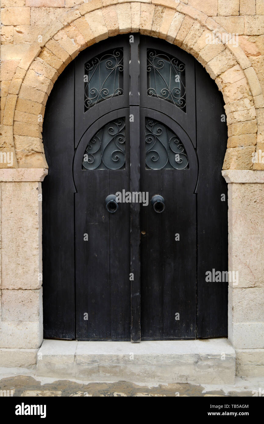 A Modern Dark Wooden Door With Cast Iron Designs Of An Old House In An Alleyway In The Medina Old City Of Tunis Tunisia Stock Photo Alamy