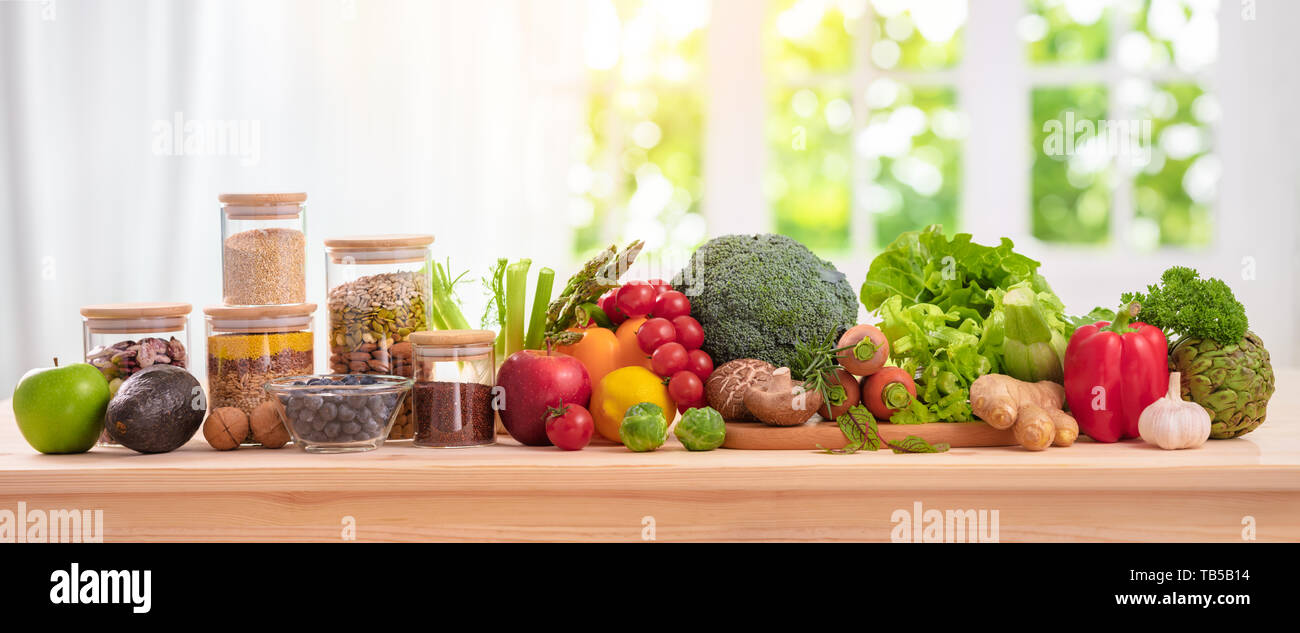 balanced diet, cooking, culinary and food concept,close up of vegetables, fruit,nut and cereal on wooden table - Stock Image