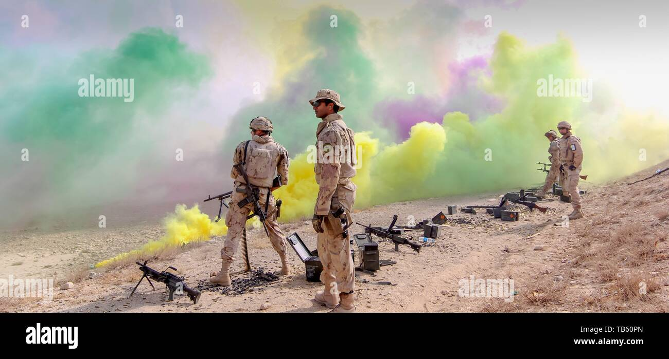 KABUL, AFGHANISTANISTAN - 10/24/2013: Army training ground near Kabul, Afghanistan. Troops stand and shooting. Smoke bombs. - Stock Image