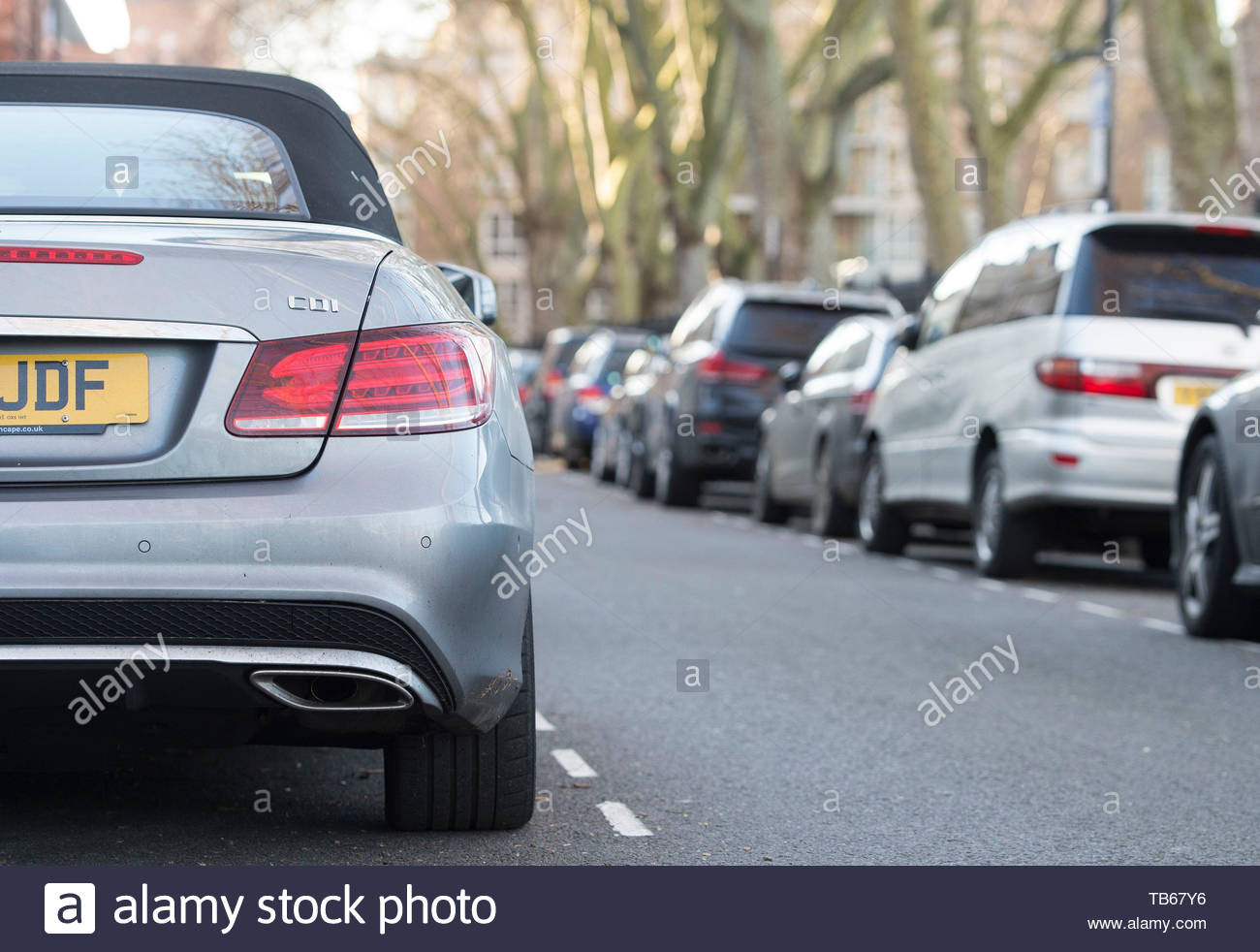 File photo dated 16/01/16 of cars parked on a residential street in London. National guidelines for sharing parking data will make it easier for drivers to find a space, the Department for Transport (DfT) has claimed. Stock Photo