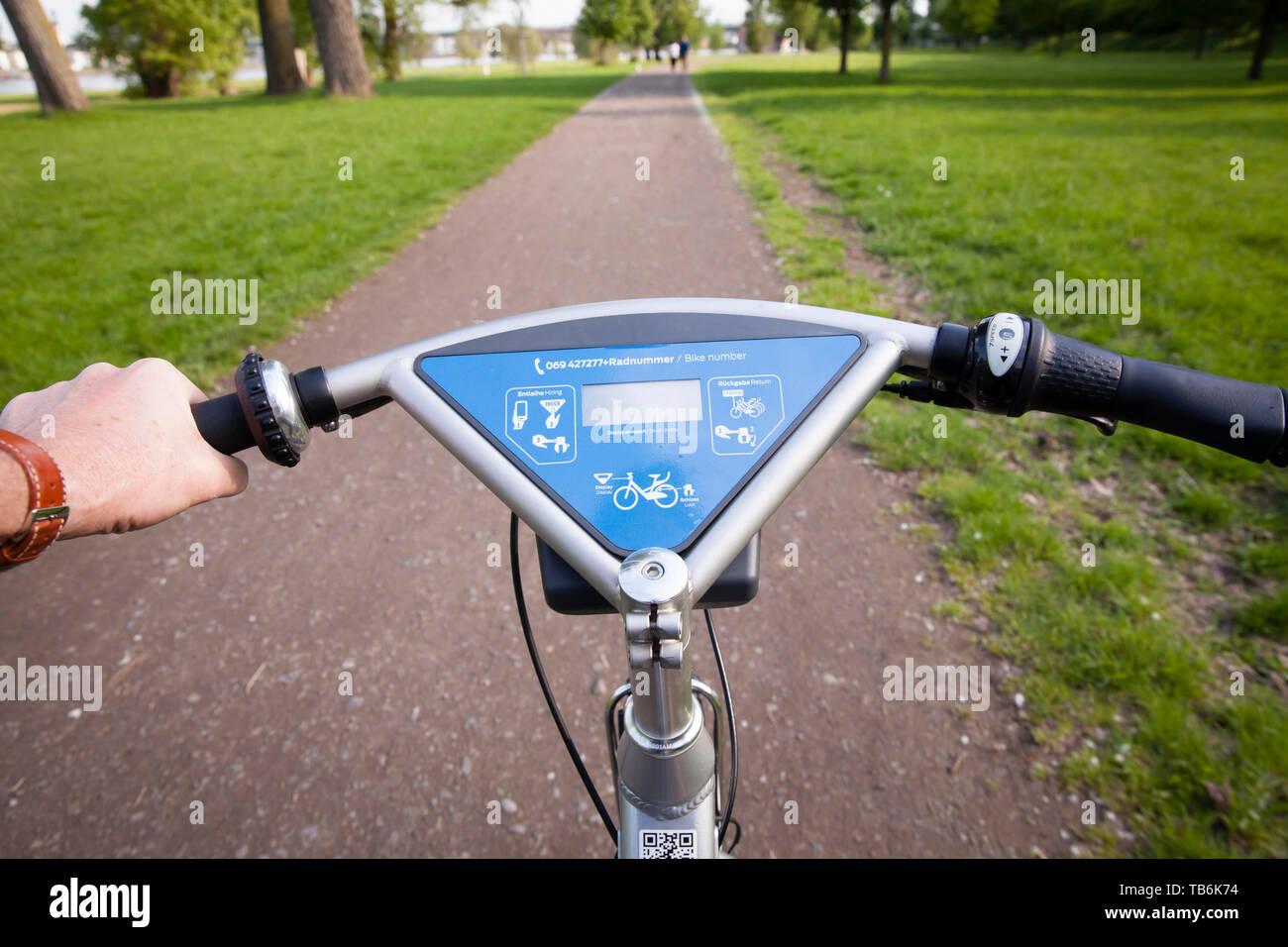 riding a rental bicycle, Ford-Pass-Bike, DB Call a Bike, Cologne, Germany.  Fahrt auf einem Mietfahrrad, Fordpass-Bike, DB Call a Bike, Koeln, Deutsch Stock Photo