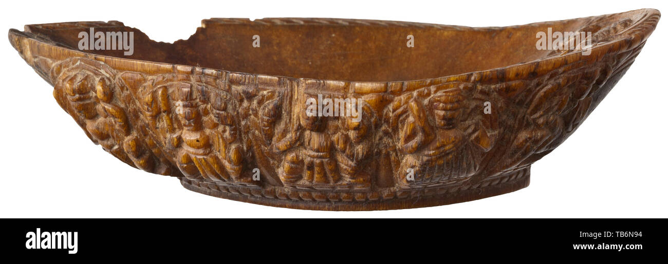 A Nepalese Vaishnava offering cup of rhinoceros horn, 17th century, Pointed oval bowl, the rim carved with geometrical ornaments. On the inside depiction of the four-armed deity Vishnu in half relief. The outside with continuous three-dimensional carvings of the ten Vishnu avatars such as Varaha with a boar's head, the lion-headed Narasimha, Parusharama, Rama, Balarama, etc. Minor chippings at the point and on one side. Length 10.6 cm, weight 55.5 g. The Nepalese rhinoceroses live in the Terai region at the foot of the Himalayas close to the Indi, Additional-Rights-Clearance-Info-Not-Available Stock Photo