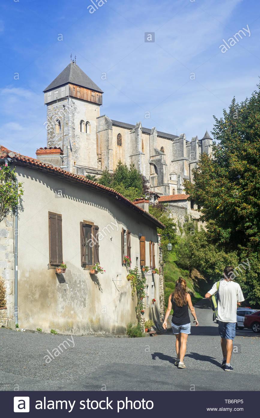 Tourists visiting the village Saint-Bertrand-de-Comminges, Haute-Garonne, Pyrenees, France Stock Photo